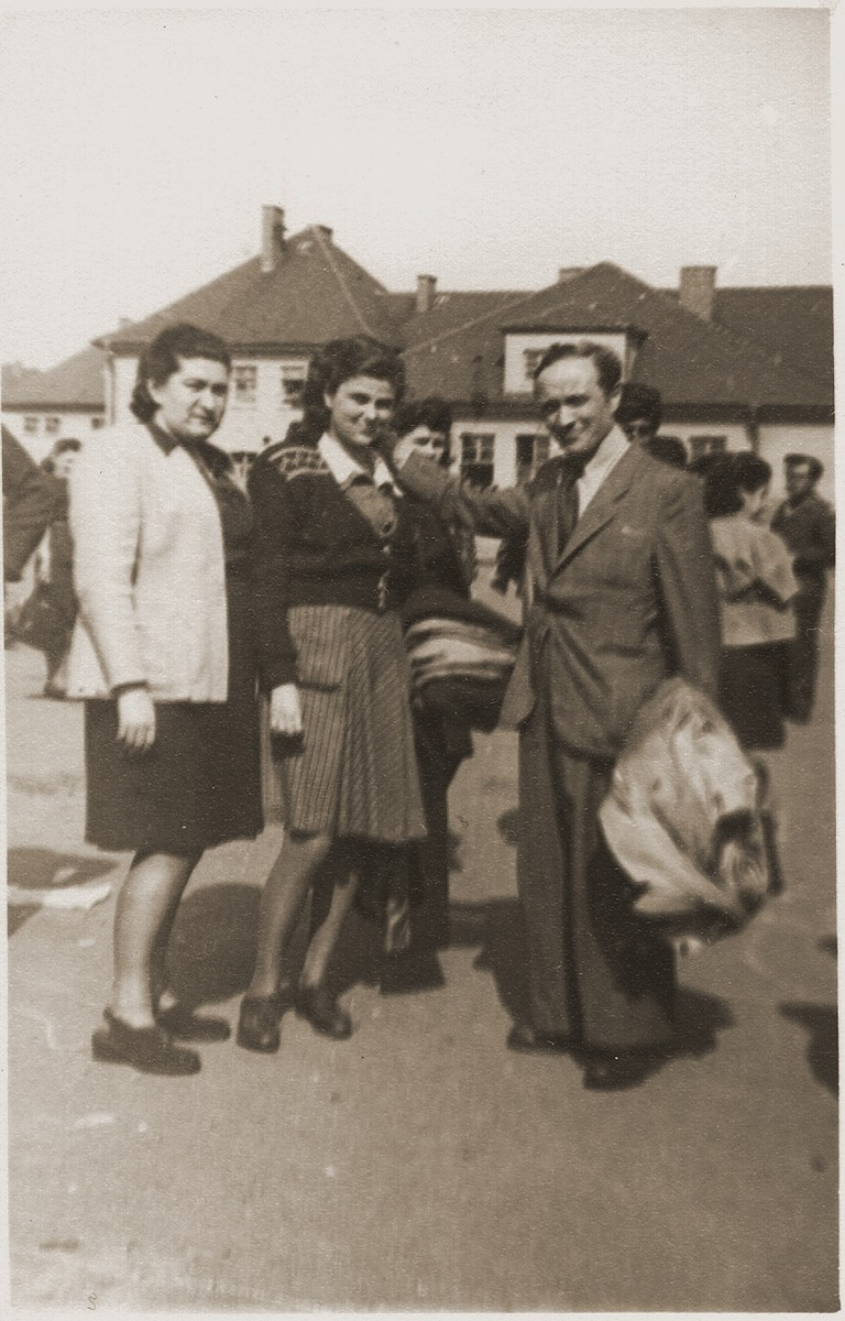 Hadassah Bimko (left) and Josef Rosensaft (right) pose with one of the teenage orphans who is about to leave the Bergen-Belsen displaced persons' camp on the first authorized children's transport to Palestine.  The group sailed aboard the SS Champollion from Marseilles.