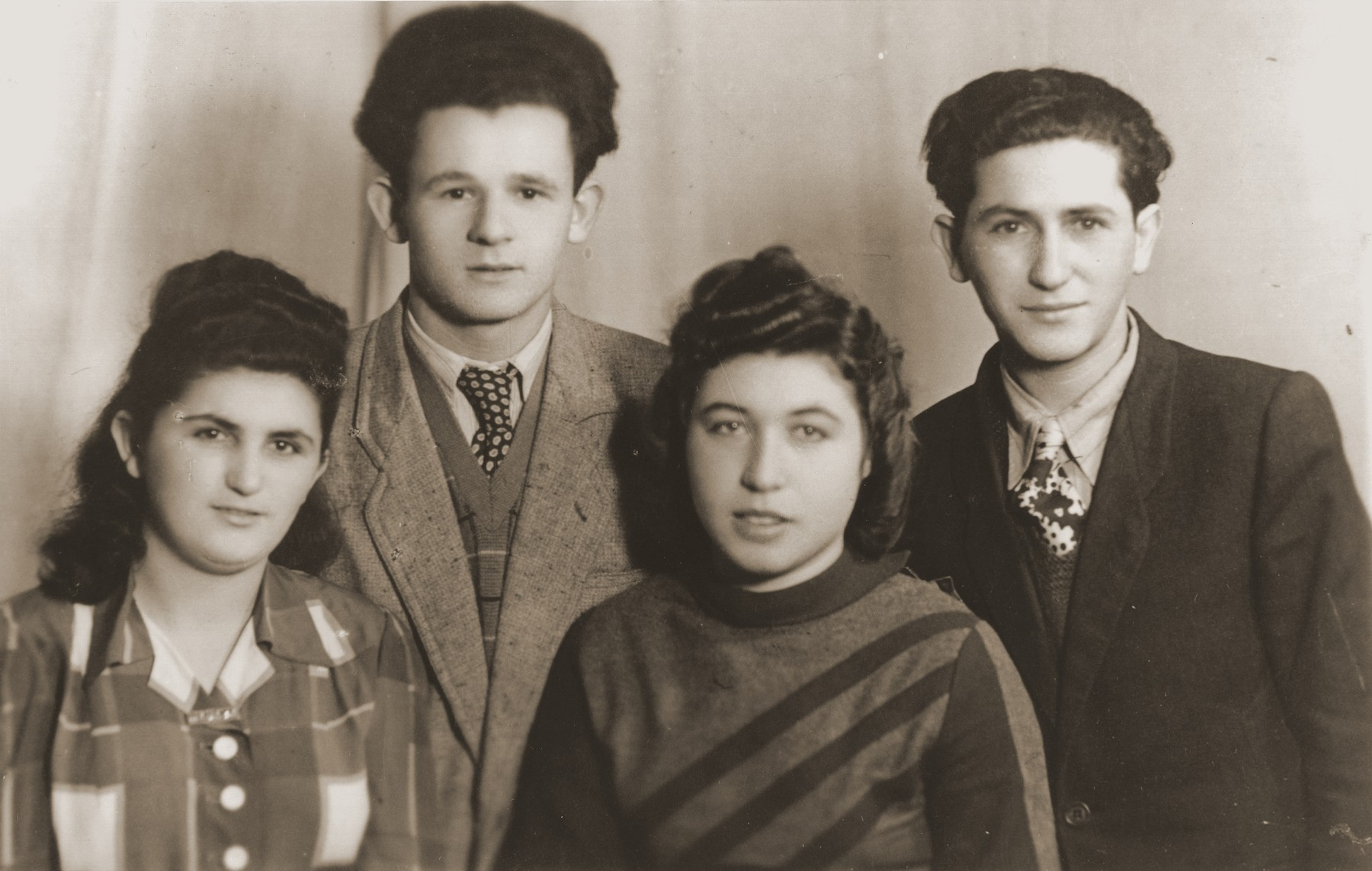 Group portrait of four young people in the Bad Reichenhall displaced persons camp.  Rochelle Szklarski is pictured second from right.
