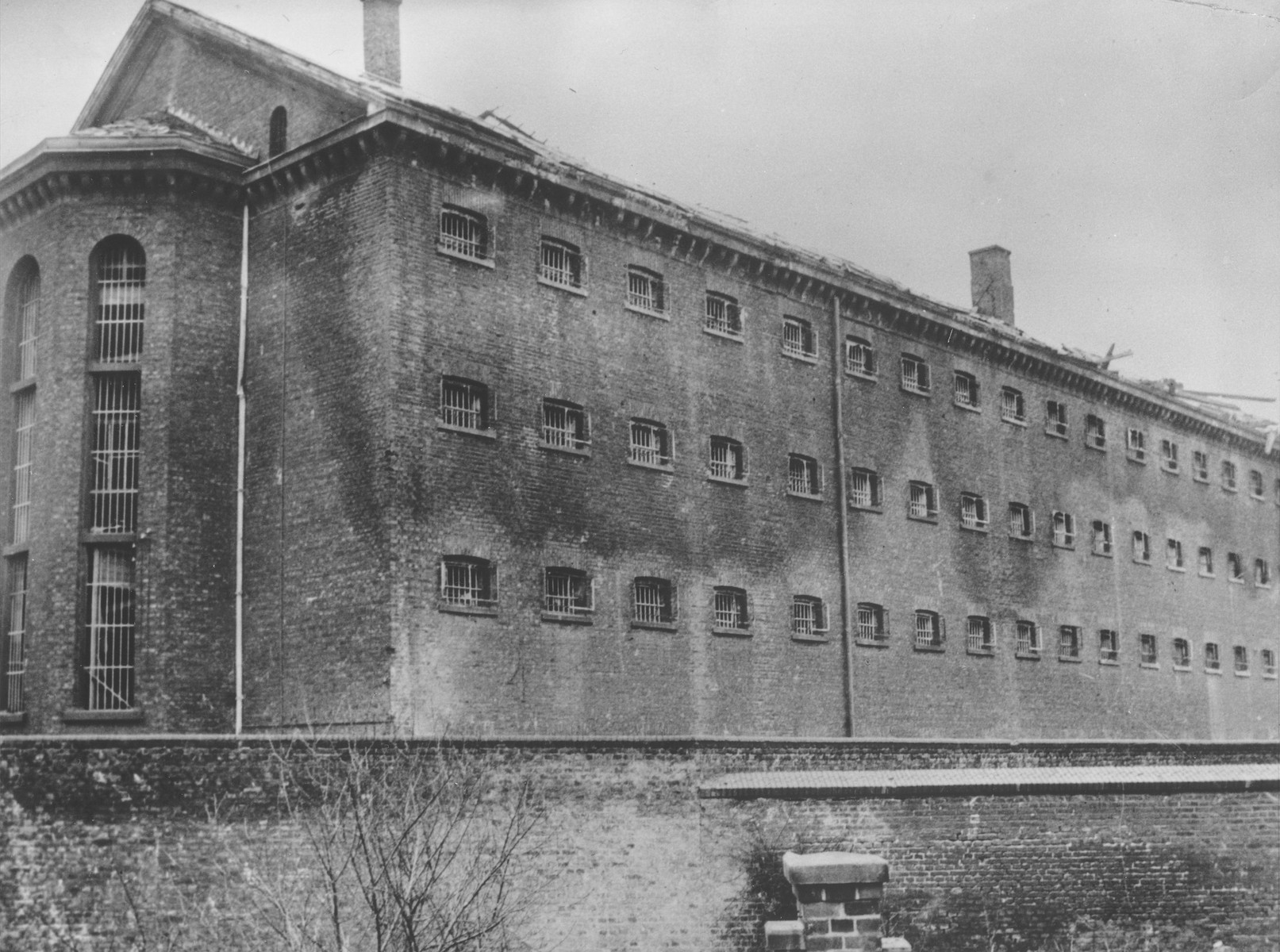 View of one wing of a Gestapo prison in Koeln.  It was the only wing of the prison that escaped bombing by Allied warplanes.  The entire building contained nearly a quarter-mile of cells.  Most of the inmates were charged with being members of the underground and with aiding or hiding Russians and Poles.  Upon the prison's capture by First U.S. Army troops on 6 March 1945, 80 prisoners remained.