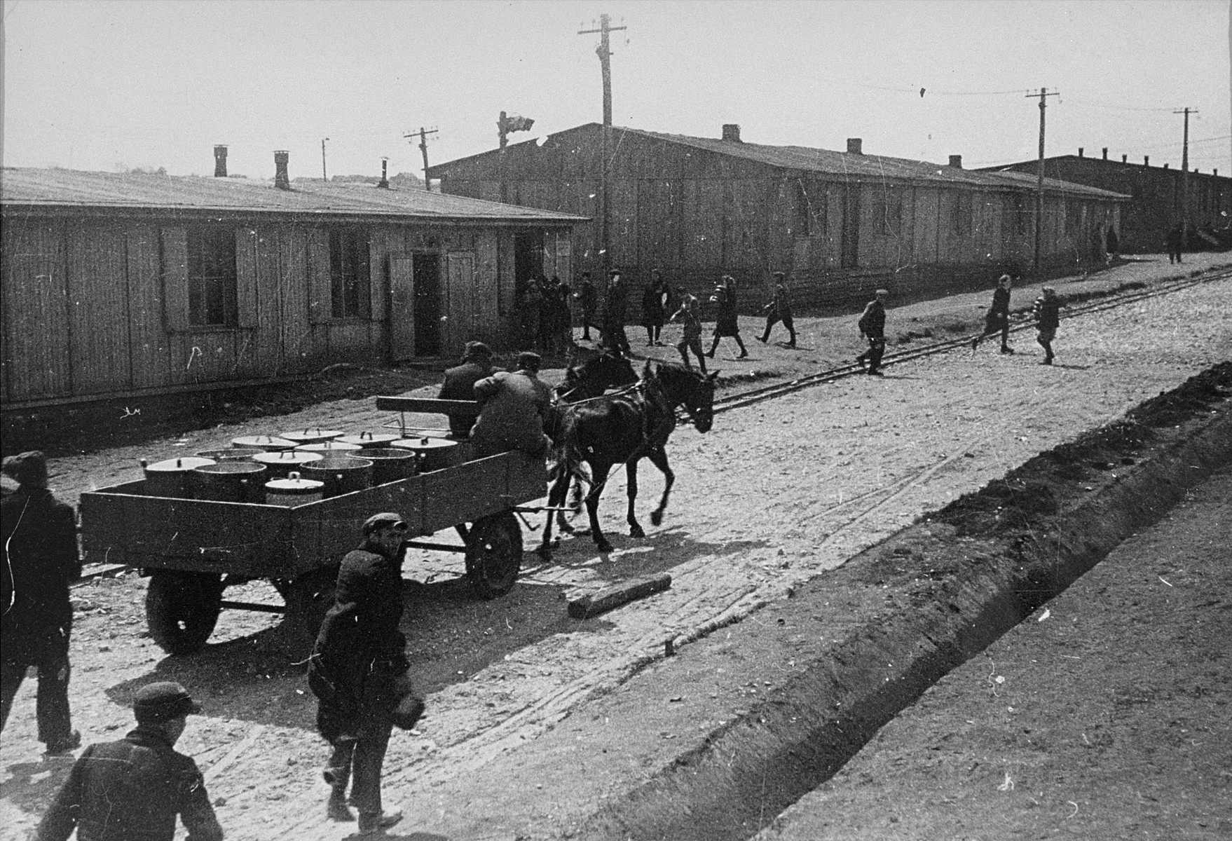A cart transports food to prisoners in Plaszow.