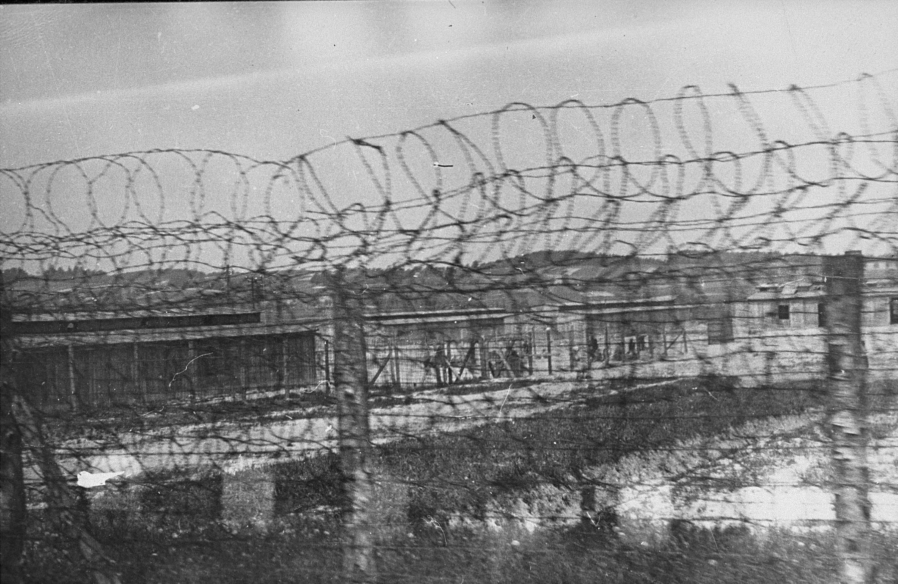 A section of the Plaszow concentration camp behind barbed wire.