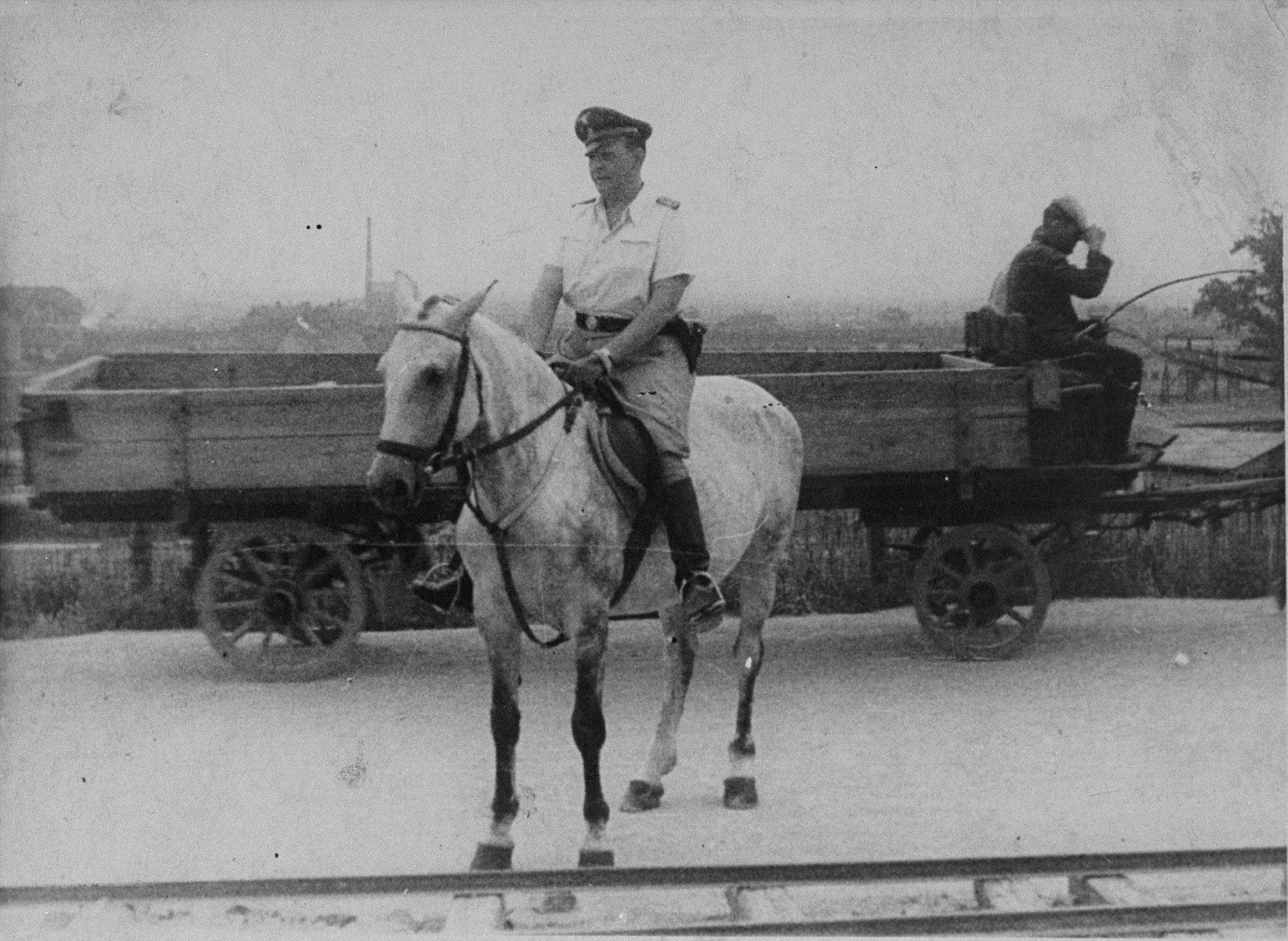 Commandant Amon Goeth rides his horse in the Plaszow concentration camp.