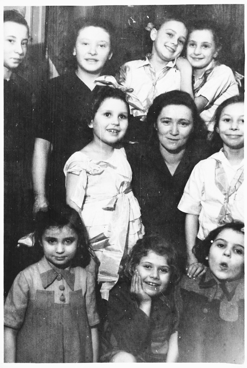 Jewish children and staff at an orphanage in Lodz run by the Koordynacja (Coordination Committee).   All of the children at the home had been hidden by Christian families during the war.  Pictured are Ania, Rela, Nina, Danuzia, Basia, Dienja, Wandercerka, Halinka, Juka, and Renia.