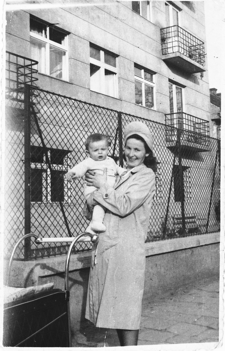 A Jewish woman poses with  her baby.  Pictured are Berte Akerman, holding Moshe Tomas.