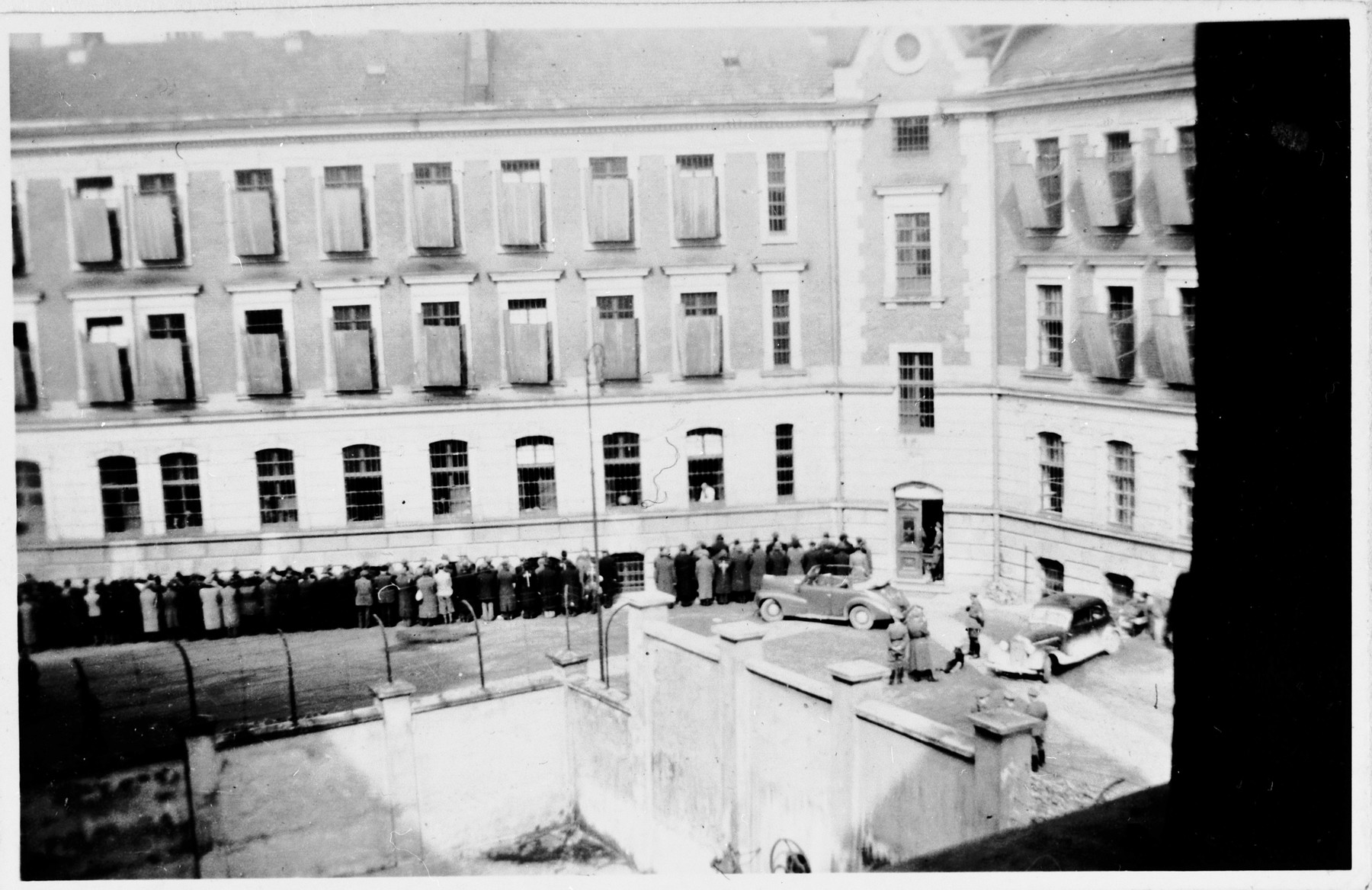 Civilians arrested by German police are held prisoner in the courtyard of the Montelupich prison in Krakow.