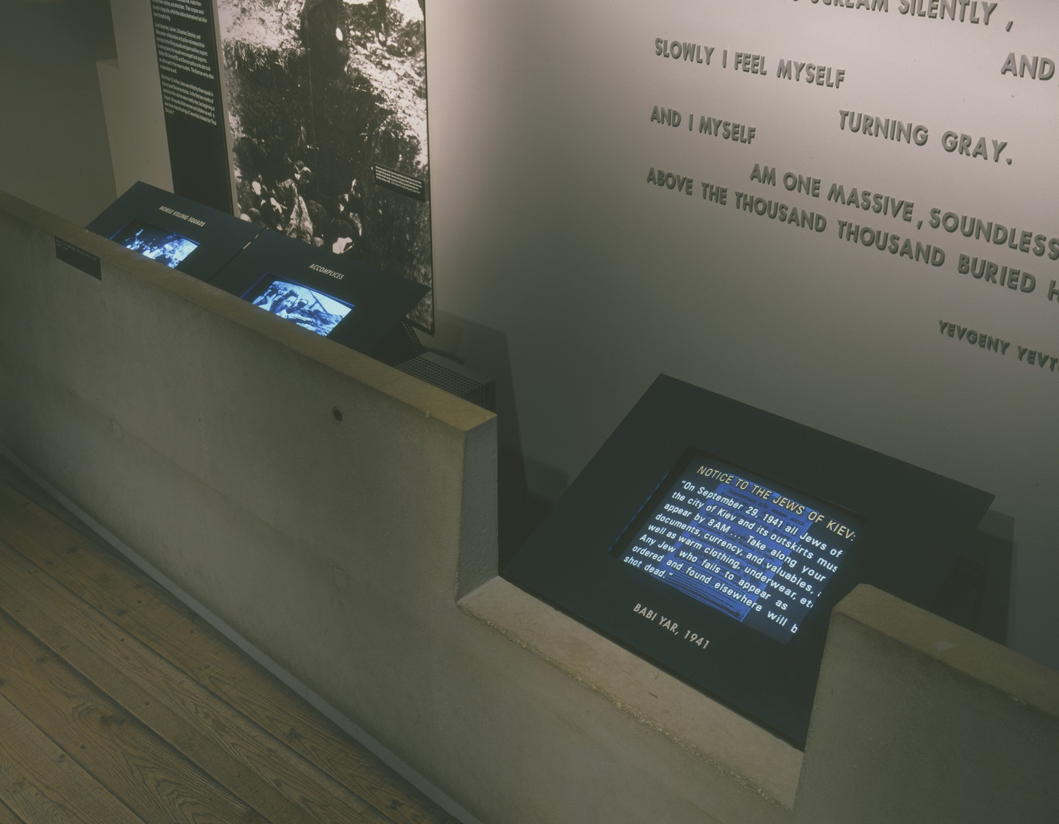 Monitors accompanying the Babi Yar and mobile killing squads segment on the third floor of the permanent exhibition at the U.S. Holocaust Memorial Museum.