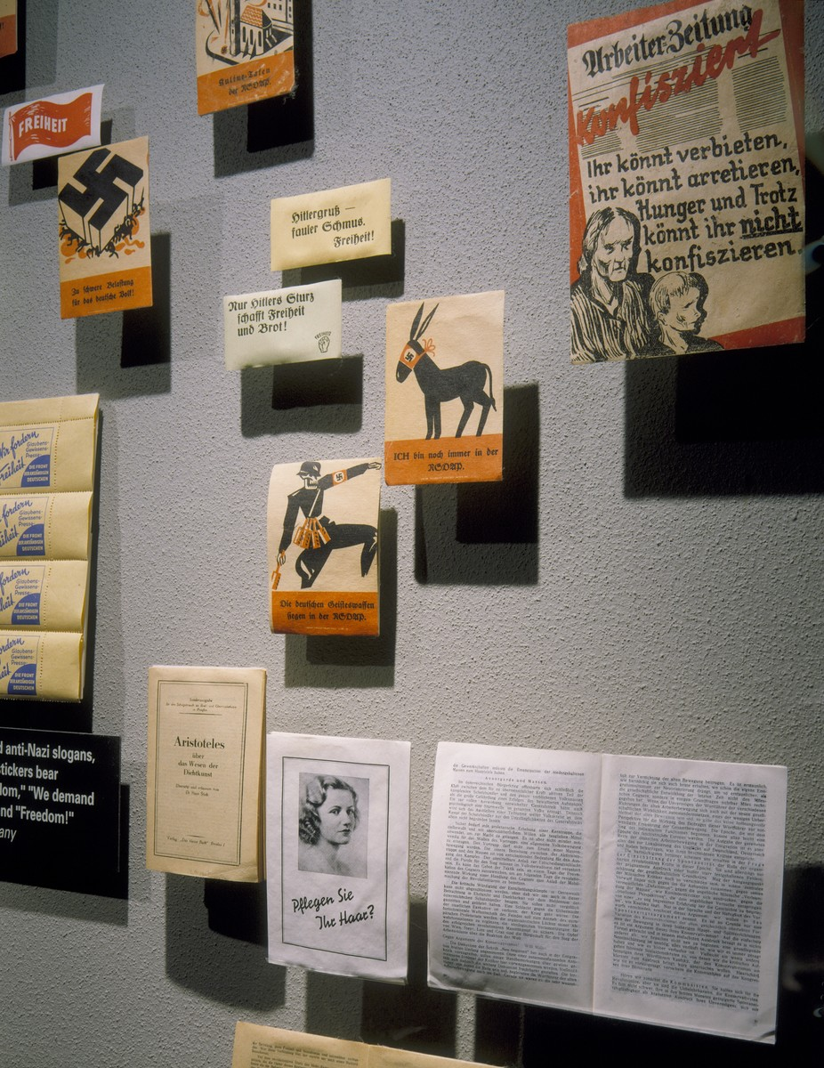 """Detail of the """"Enemies of the State"""" segment, featuring anti-Nazi pamphlets published by communists and social democrats operating from France and Czechoslovakia, on the fourth floor of the permanent exhibition at the U.S. Holocaust Memorial Museum."""