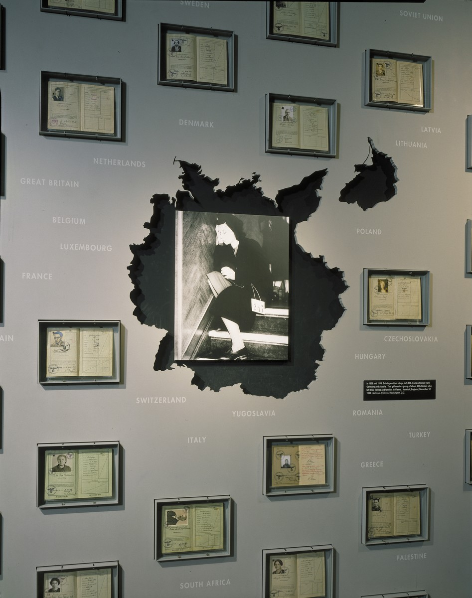 "One panel of the ""Search for Refuge"" segment, featuring the passports of Jewish refugees, on the fourth floor of the permanent exhibition at the U.S. Holocaust Memorial Museum."