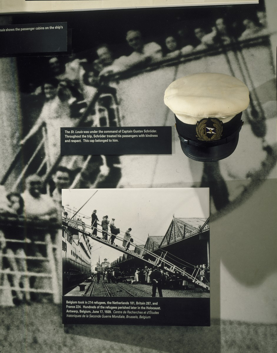 "Detail of the ""MS St. Louis"" photo mural with Captain Schroeder's cap on the fourth floor of the permanent exhibition at the U.S. Holocaust Memorial Museum."