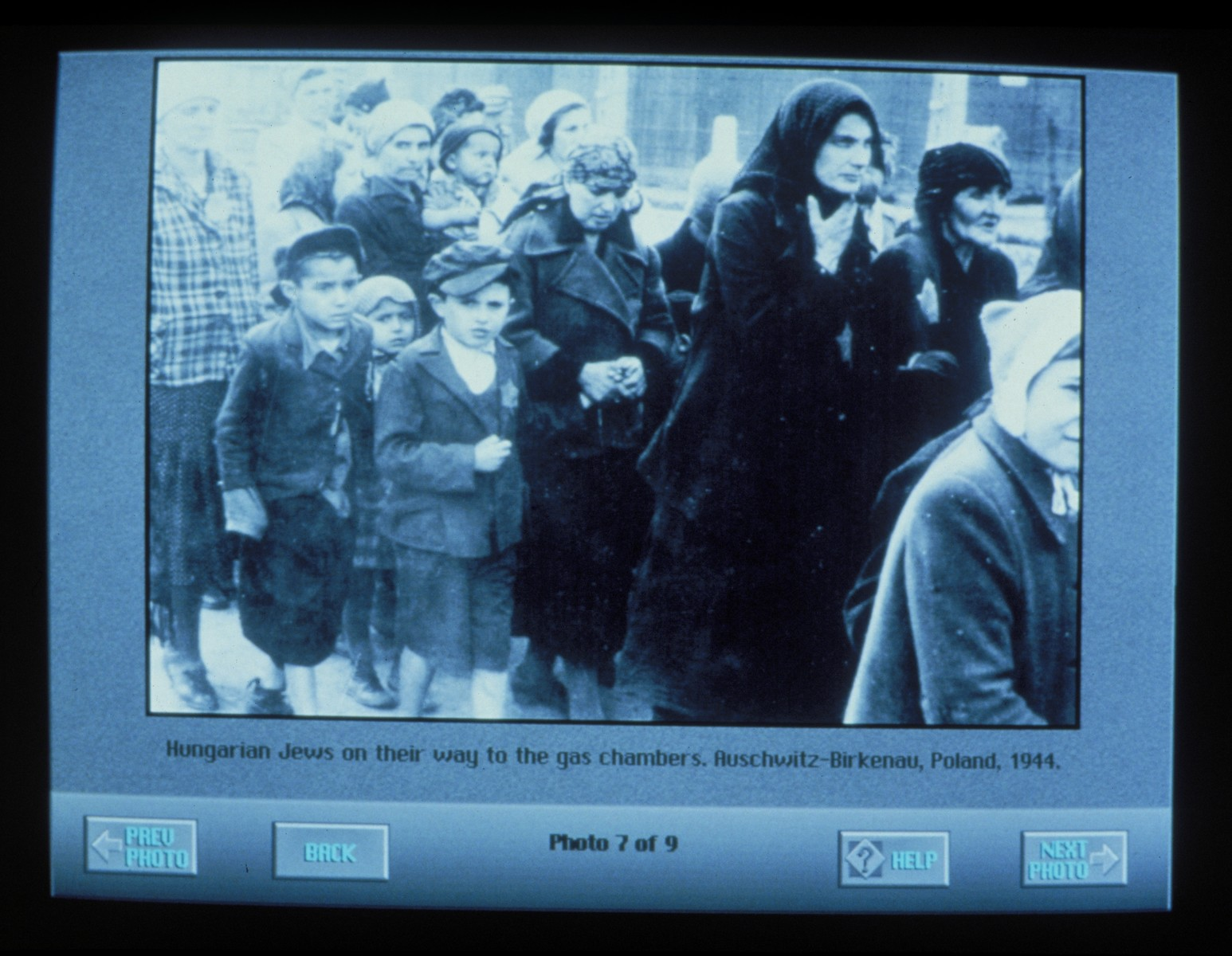 Wexner Learning Center computer monitor displaying an image of the arrival of Jews from Carpathian Ruthenia to Auschwitz-Birkenau.