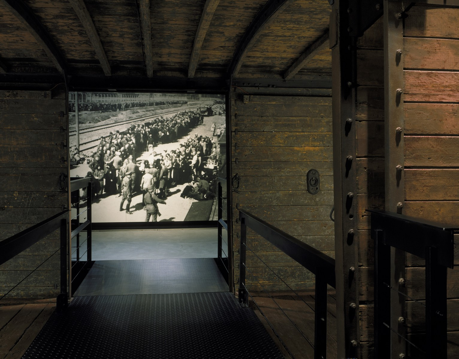 View of the photo mural of a selection at Auschwitz-Birkenau taken through the open railcar on the third floor of the permanent exhibition at the U.S. Holocaust Memorial Museum.