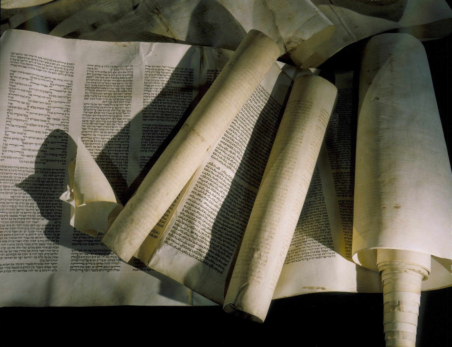 Torah scrolls desecrated during the Kristallnacht pogrom, are displayed on the fourth floor of the permanent exhibition at the U.S. Holocaust Memorial Museum.