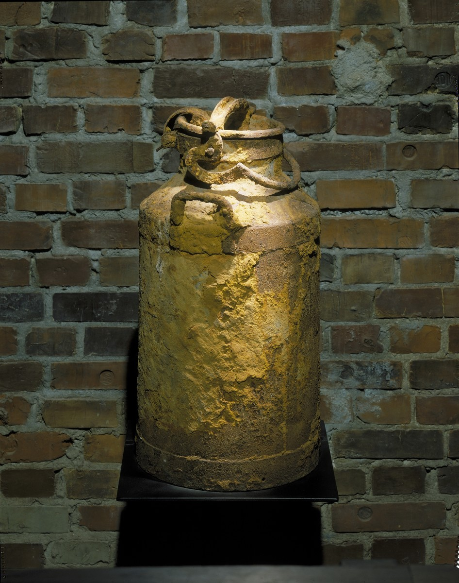 "One of the three milk cans used by Warsaw ghetto historian Emanuel Ringelblum to store and preserve the secret ""Oneg Shabbat"" ghetto archives.  This milk can, identified as no. 2, was unearthed at 58 Nowolipki Street in Warsaw on December 1, 1950.   The milk can and casting of the Warsaw ghetto wall are displayed on the third floor of the permanent exhibition at the U.S. Holocaust Memorial Museum."