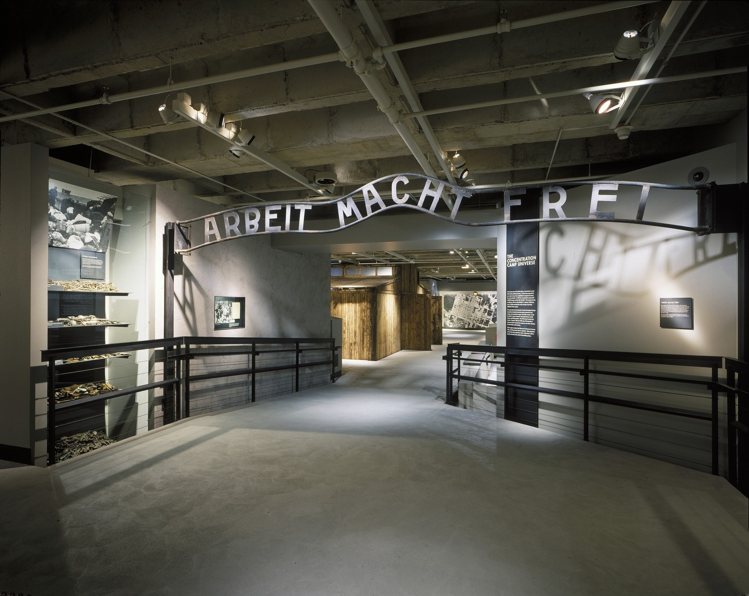 "View of a casting taken of the gate to the main camp at Auschwitz with the sign ""Arbeit Macht Frei"" [Work Makes One Free] that is displayed on the third floor of the permanent exhibition in the U.S. Holocaust Memorial Museum."