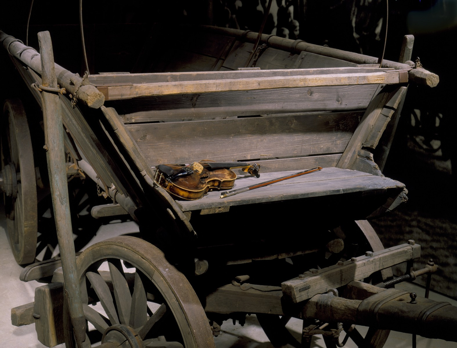 Detail of the Gypsy wagon and violin displayed on the fourth floor of the permanent exhibition at the U.S. Holocaust Memorial Museum.