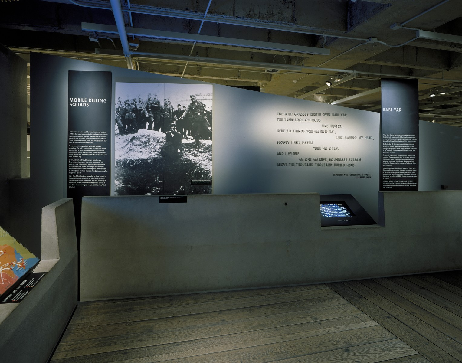 "View of the ""Mobile Killing Squads"" and ""Babi Yar"" segments on the third floor of the permanent exhibition at the U.S. Holocaust Memorial Museum."