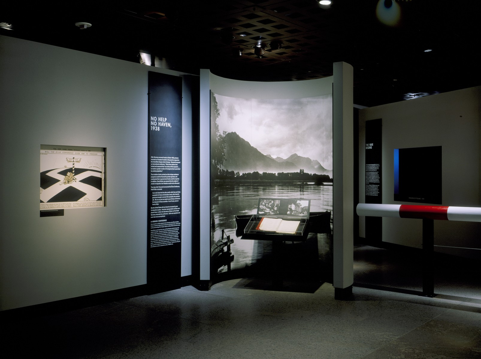 """View of the """"No Help, No Haven, 1938"""" display, featuring the guest book from the Hotel Royal in Evian-les-Bains, on the fourth floor of the permanent exhibition at the U.S. Holocaust Memorial Museum."""