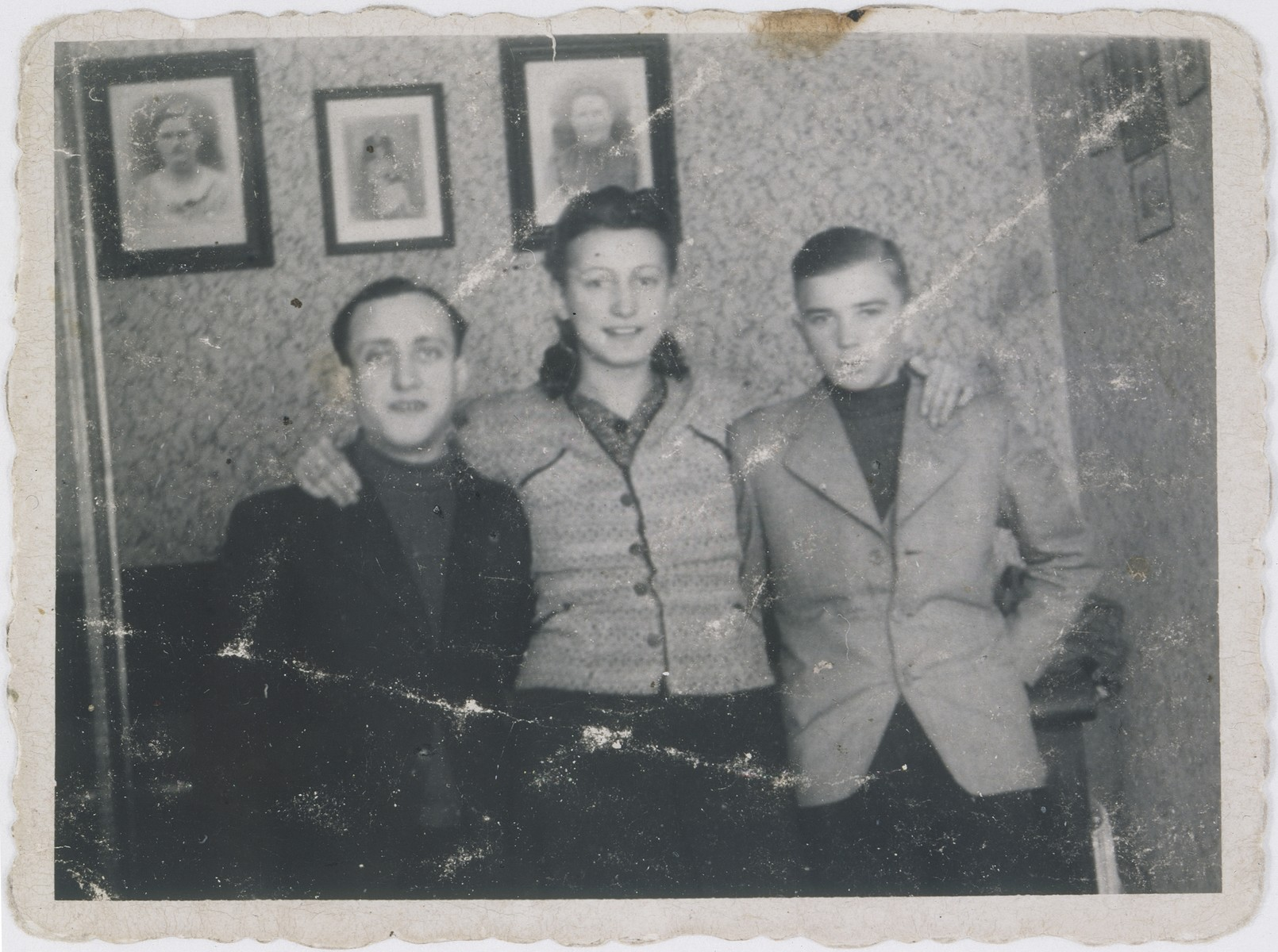 Jan Kostanski (right) poses with Fela Wierzbicka and her husband Szmulek in the Warsaw ghetto.  Fela was eight months pregnant in this photo.  She was killed shortly thereafter by the Germans and her husband, Szmulek, went mad upon hearing the news.