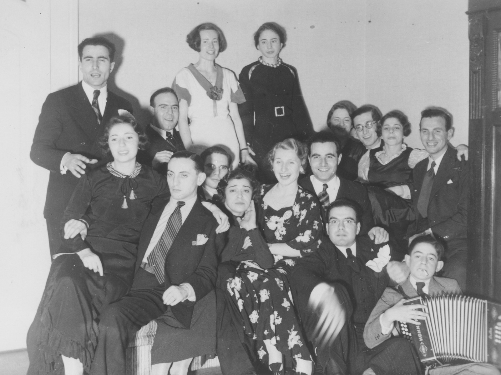 Gathering of a Fascist social club in Berlin.  Gitta Schadur is pictured in the center with her hand on her cheek.
