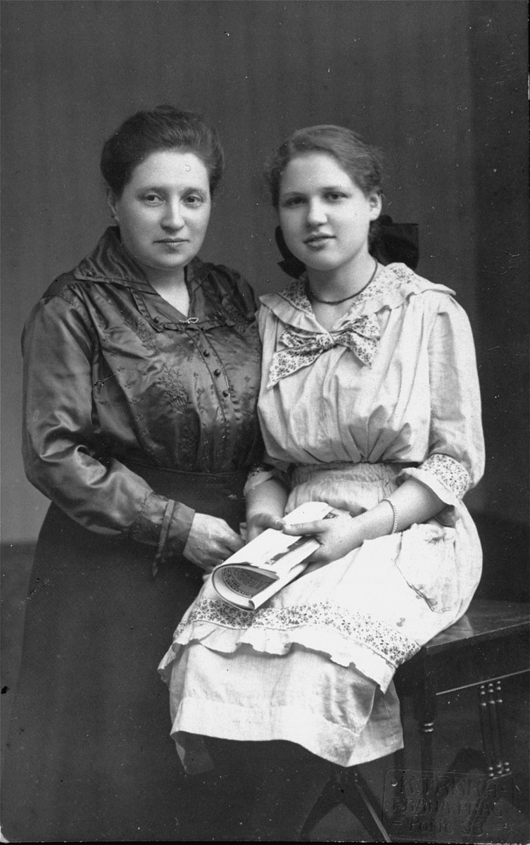 Studio portrait of a Jewish mother and daughter in Prague, Czechoslovakia.  Pictured are Olga (Ola) Fischl with her daughter, Clothilde.  Olga was the sister of Emilia Kohn (who was married to Viktor Kohn).  Both Olga and Clothilde perished during the war.
