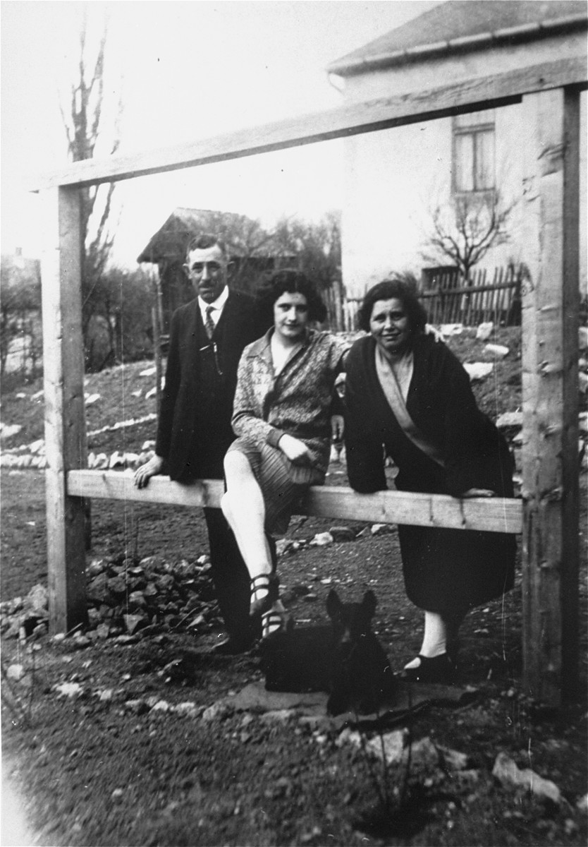Olga (Deuts) Leier poses with her parents outside their home in Bratislava.