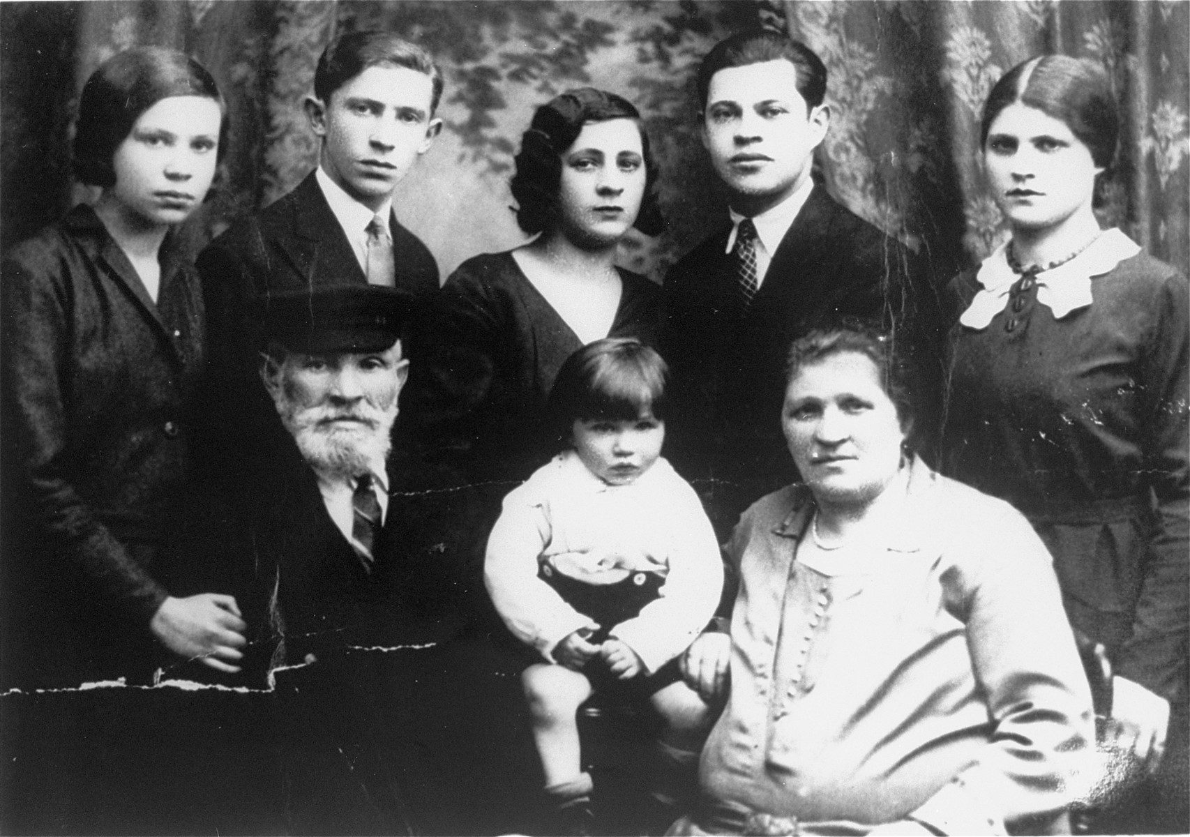 Portrait of the Stabinsky family in Belgium.  Among those pictured is Leon Stabinsky (the young boy).  He survived the war in hiding.