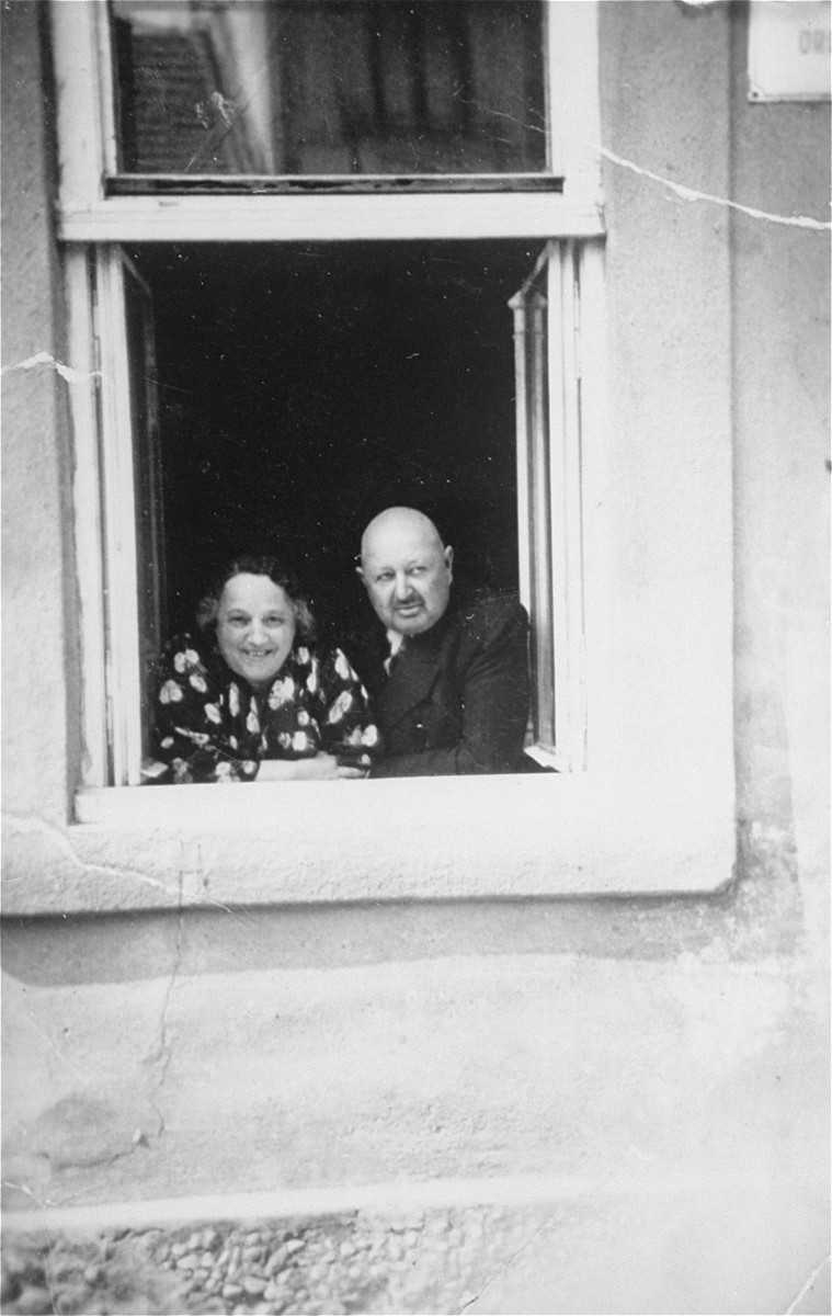 Portrait of the donor's parents, Jakub and Lilly Herzog, looking out of a window of their home in Hlohovec, Czechoslovakia.
