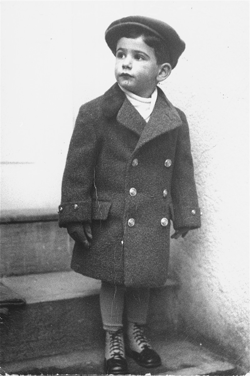 Portrait of three-year-old Tomas Kulka standing in front of his house in Olomouc, Czechoslovakia.