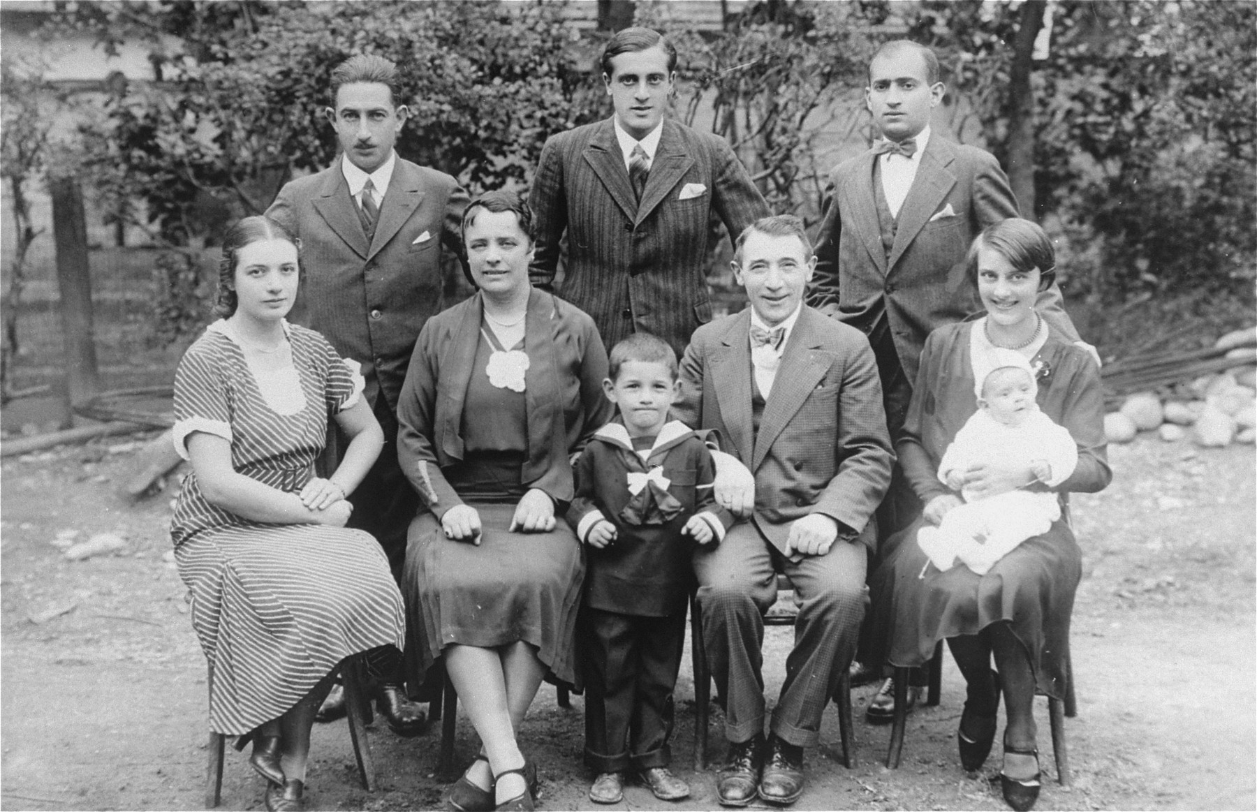 Portrait of the Riegelhaupt family.    Arie Klein stands in between his grandparents, Julia Riegelhaupt (Grinweld) and Zigmund Riegelhaupt. Also pcitured are Eva Klein's brother, Leo Riegelhaupt and sister, Joly.
