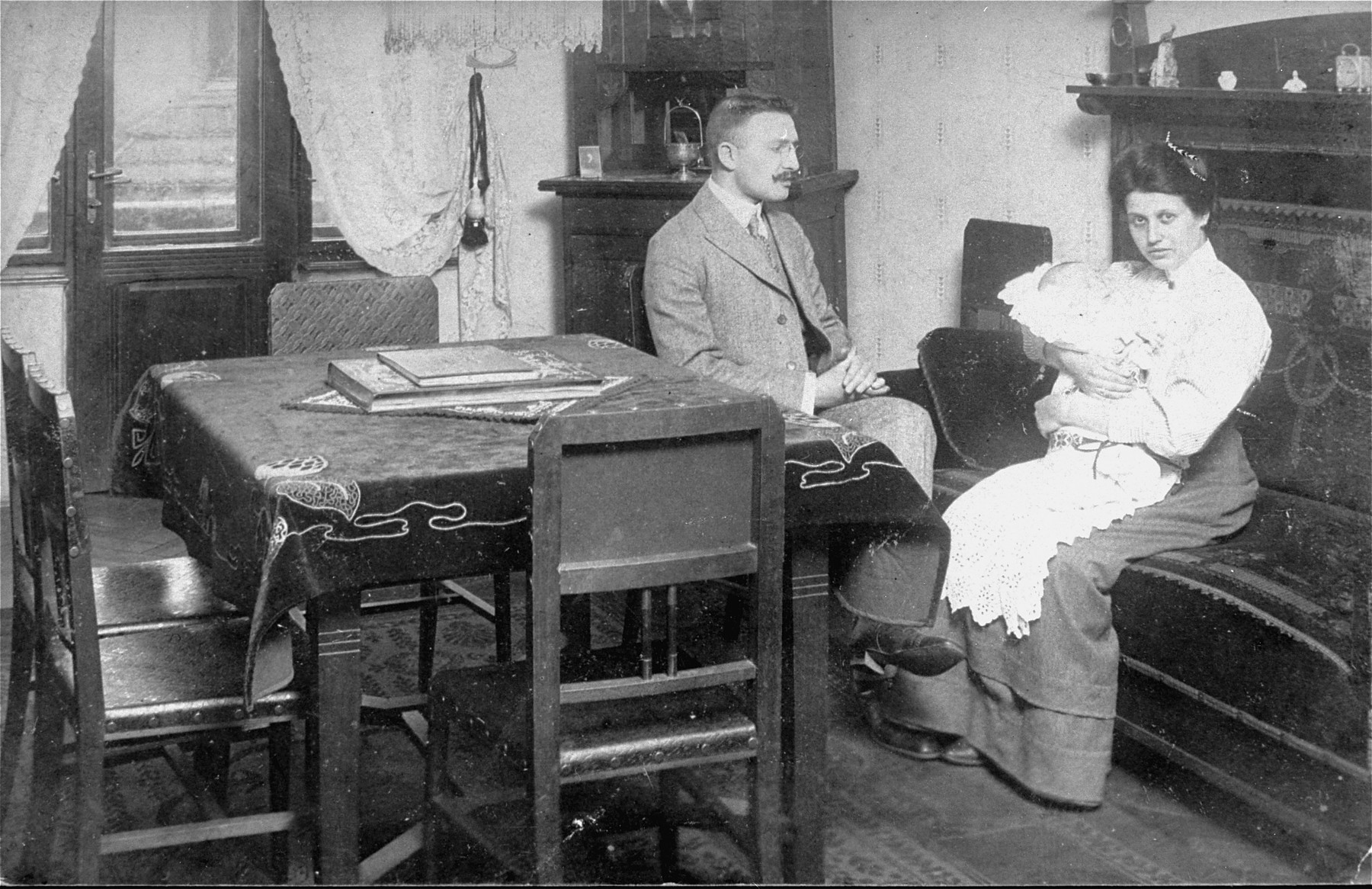 Portrait of Viktor and Emilia Kohn at home with their first child, Walter.