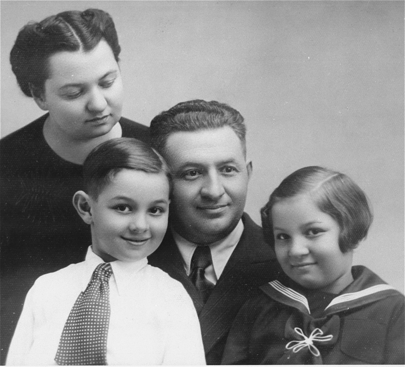 Portrait of the Muller family in Hlohovec, Czechoslovakia just prior to their departure for Canada.  Pictured are Nandor and Magda Muller and their two children, Heinrich and Alice.