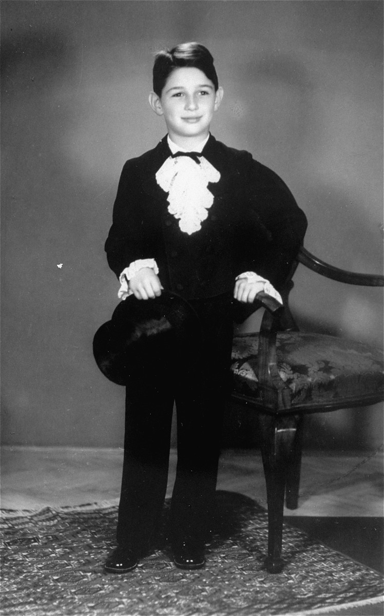 Arie Klein poses in formal ballet clothes for a final performance.