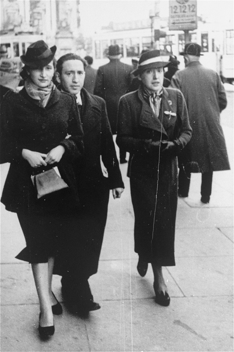 Rajala Lederman walks along a street in Brussels with two friends.