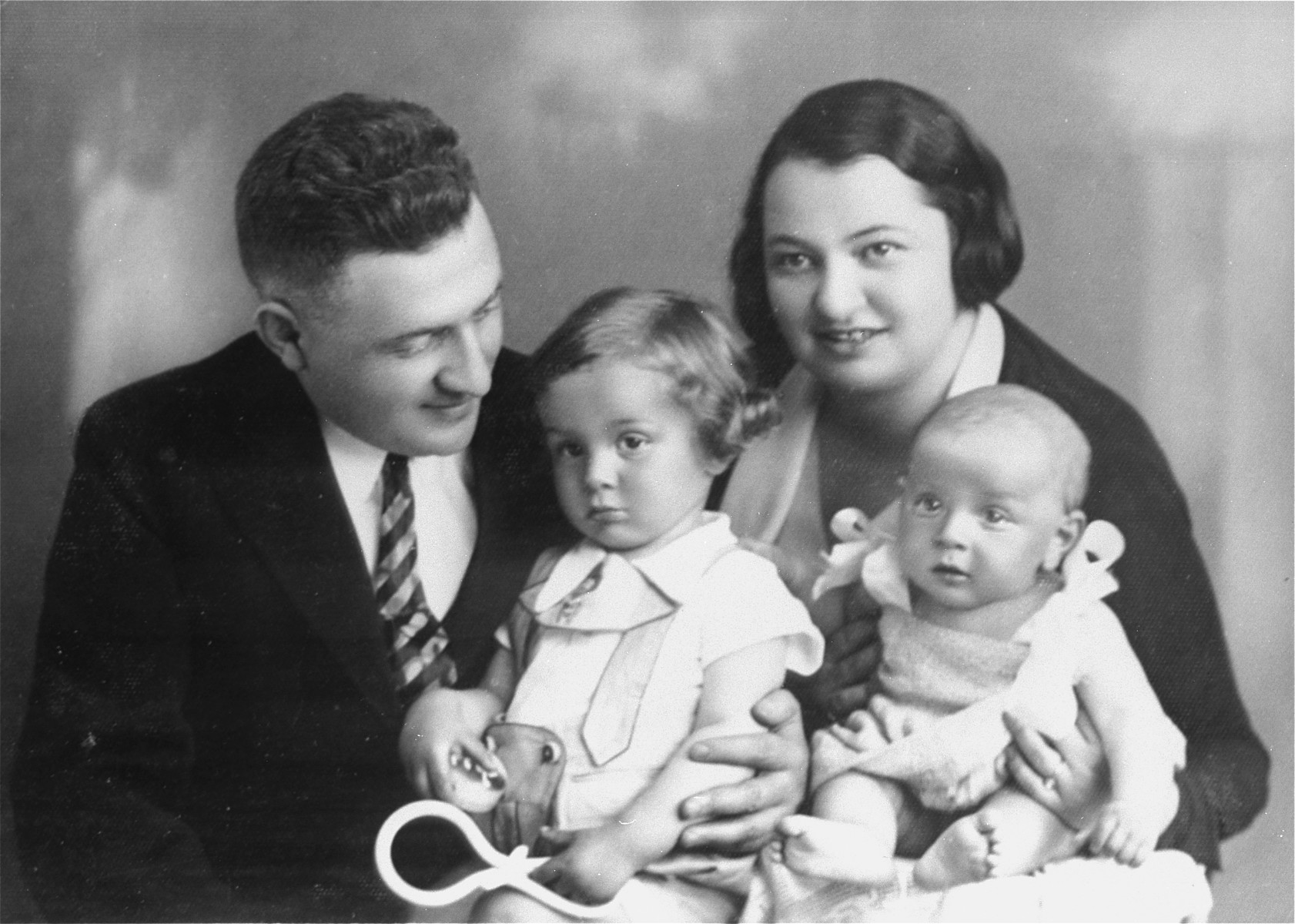 Portrait of the Muller family in Hlohovec, Czechoslovakia.  Pictured are Nandor and Magda Herzog Muller with their two children, Heinrich and Alice.