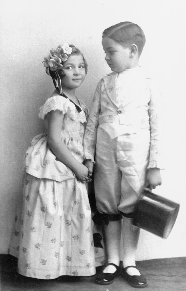 Portrait of the two Muller children, Heinrich and Alice, dressed up for a Purim celebration.
