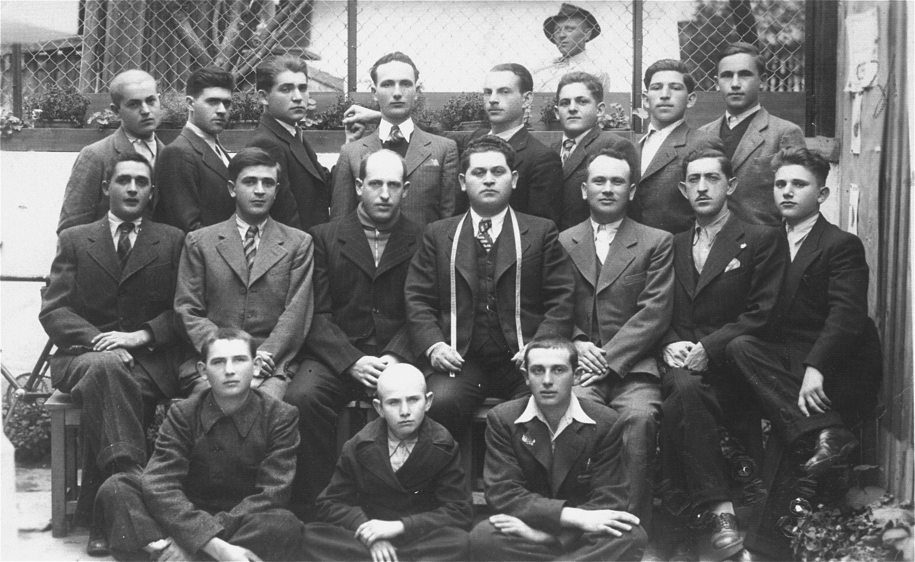 Abraham Ickovic poses with the employees of his garment factory, the Pansky a Damsky Krejci, in Tacovo.   Among those pictured are Abraham Ickovic (second row, fourth from the left) and Ludvic Ickovic (second row, first on the right). Of these eighteen men only nine survived the war.