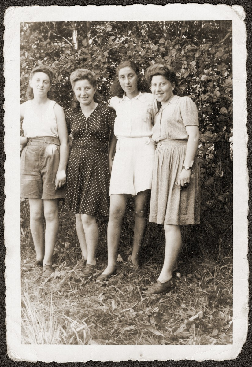Four young Jewish women pose outside at the Eschwege displaced persons camp.    Among those pictured are Hania Goldman (second from the left) and her sister, Rachela (far right).