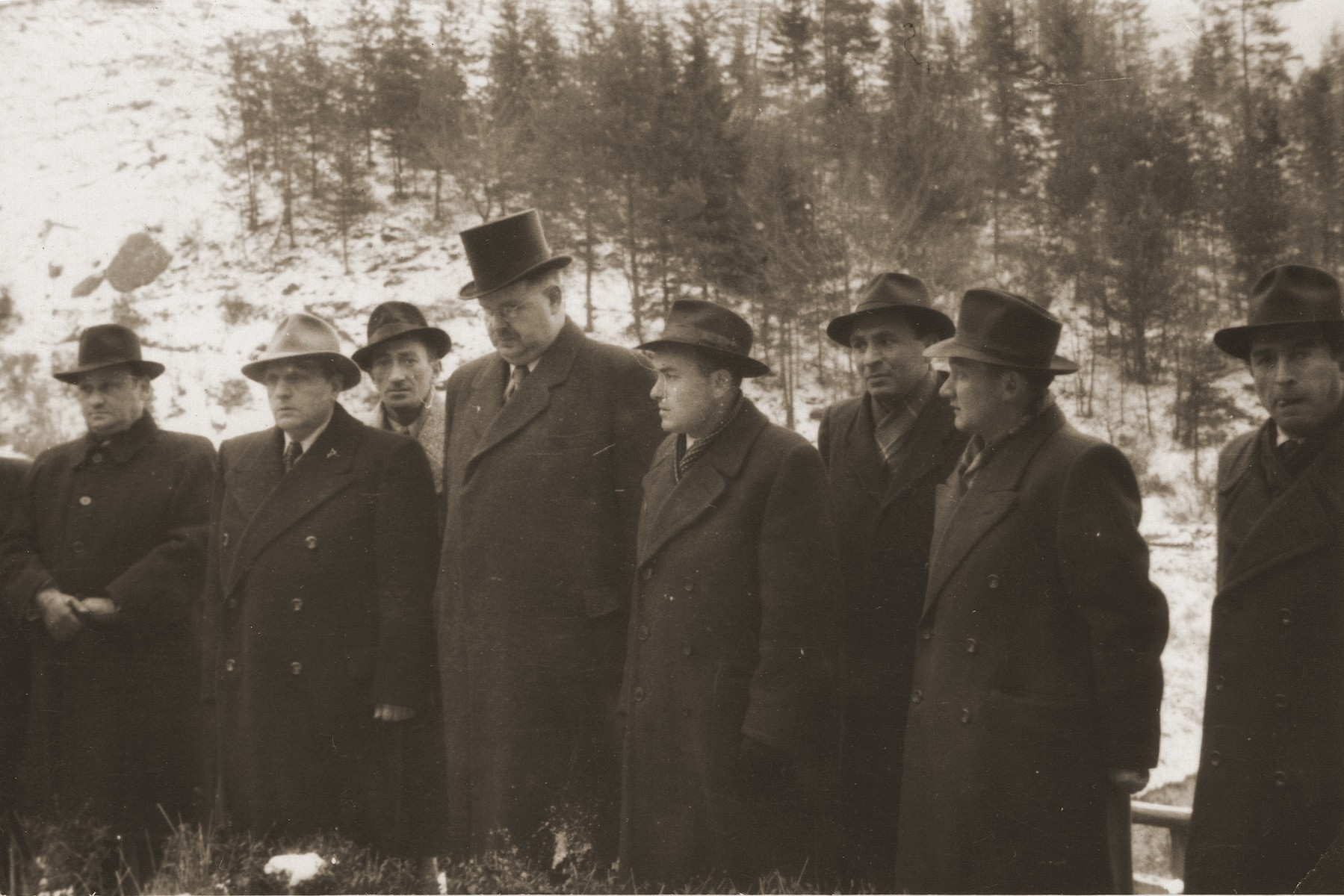 Survivors attend a memorial service for Jewish victims at the Flossenbuerg concentration camp.   From left to right are Israel Igster, Weingarten, ?, Philipp Auerbach, Palucki, Motek Fishel, and Krzepicki.