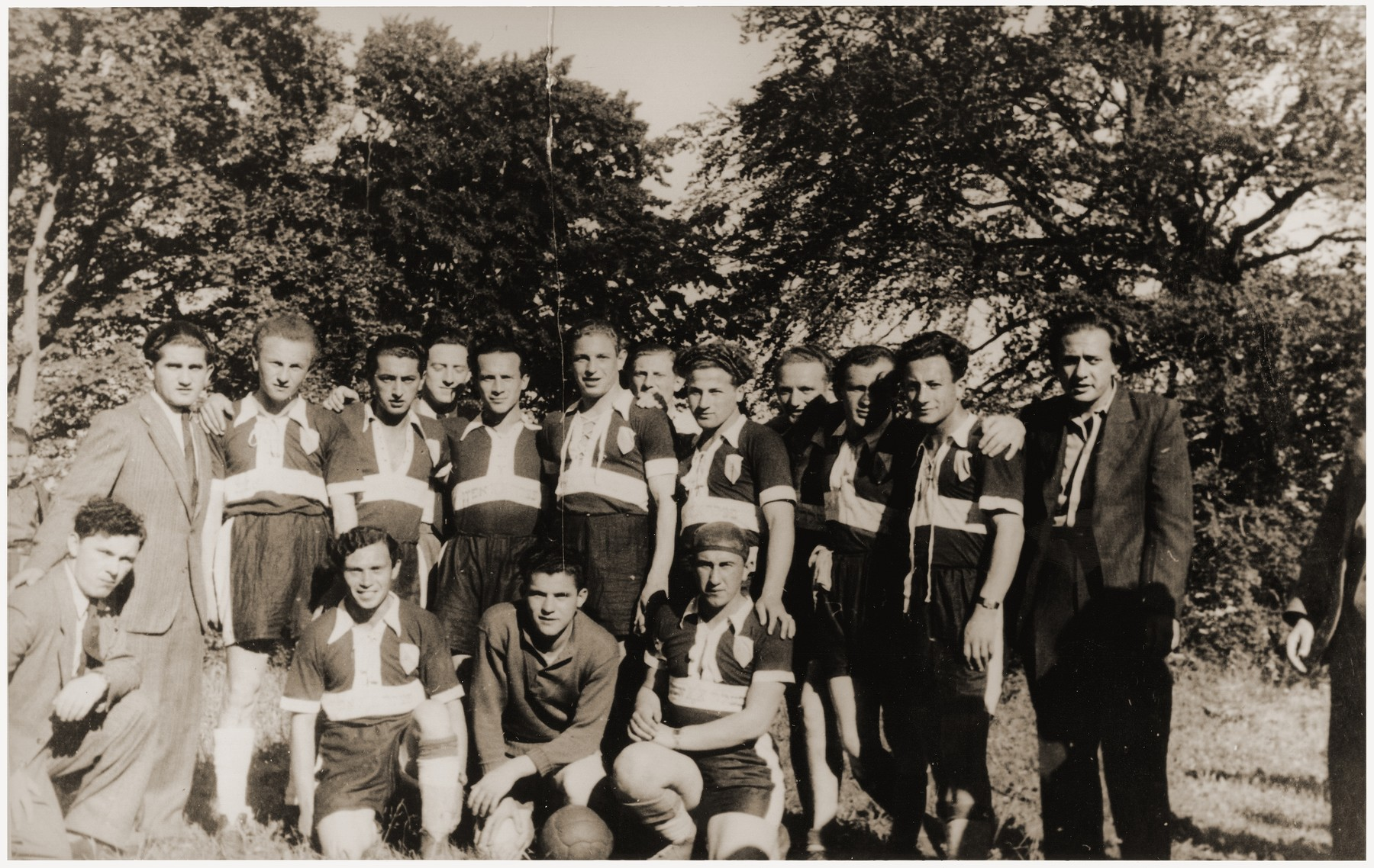 Group portrait of members of a sports team at the Feldafing displaced persons camp.  Among those pictured is Salik Schuckatowiz (second row, third from the left).