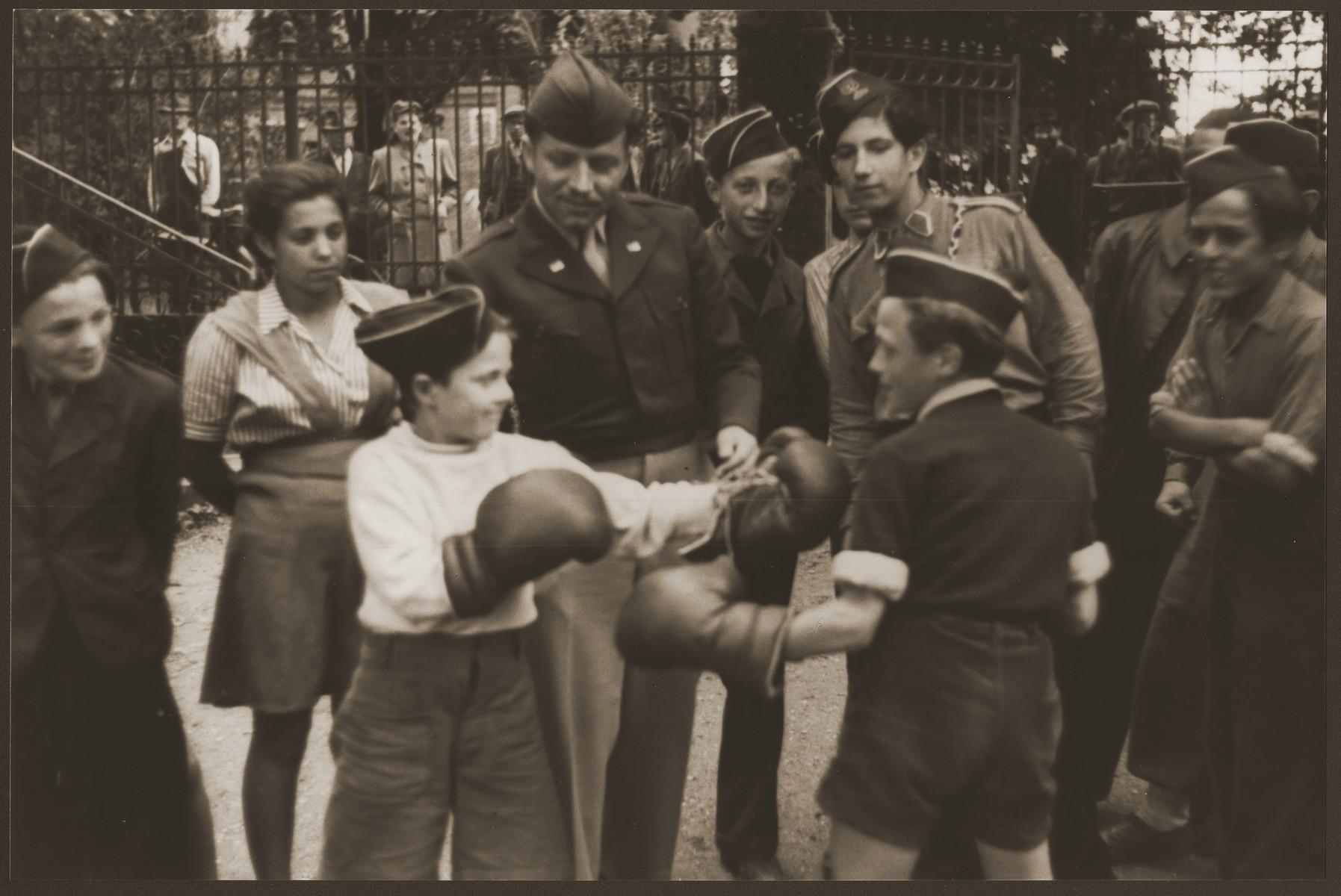 Jewish children boxing at the Vaad Hatzala sponsored Jabotinsky Children's Home.  Among those pictured is Izio Gerber (far left).