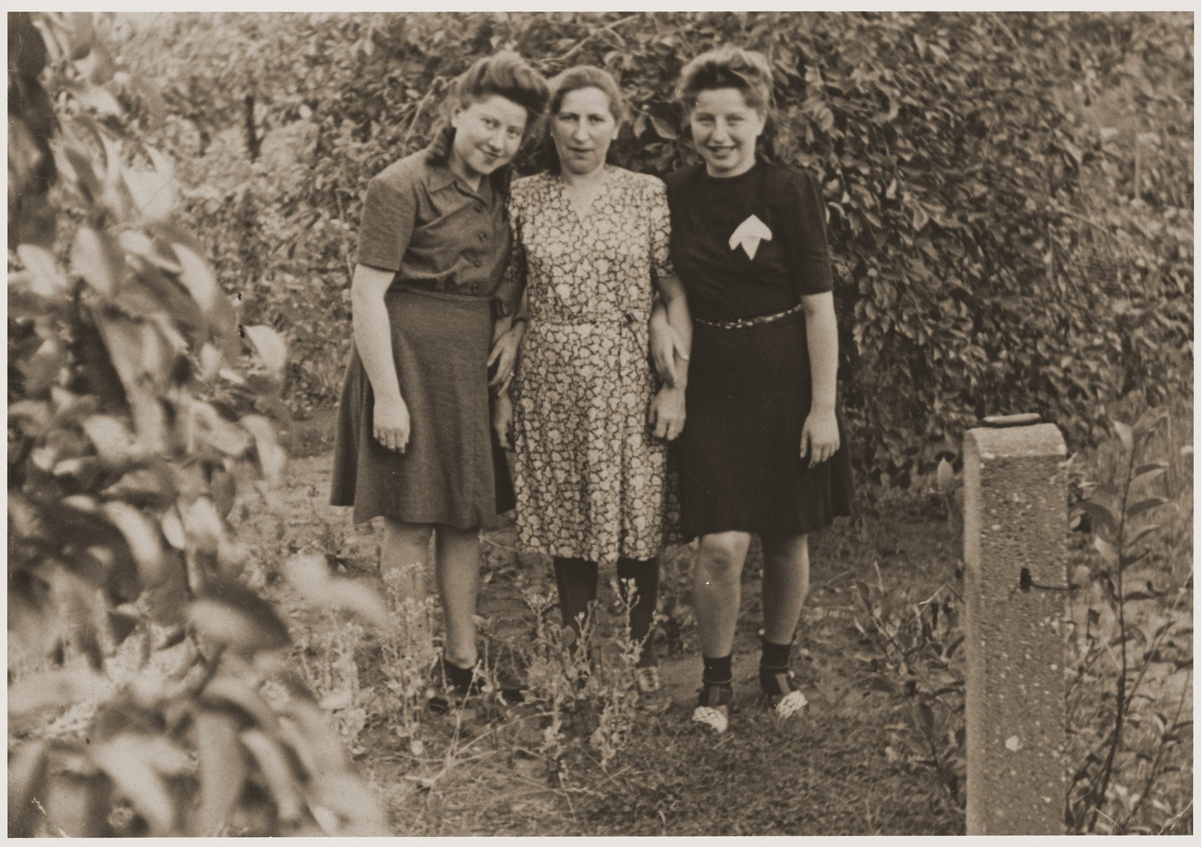 A Jewish mother poses with her two daughters at the Fuerth displaced persons camp.  Pictured are Cyla Goldman with her daughters, Hania (right) and Rachela (left).