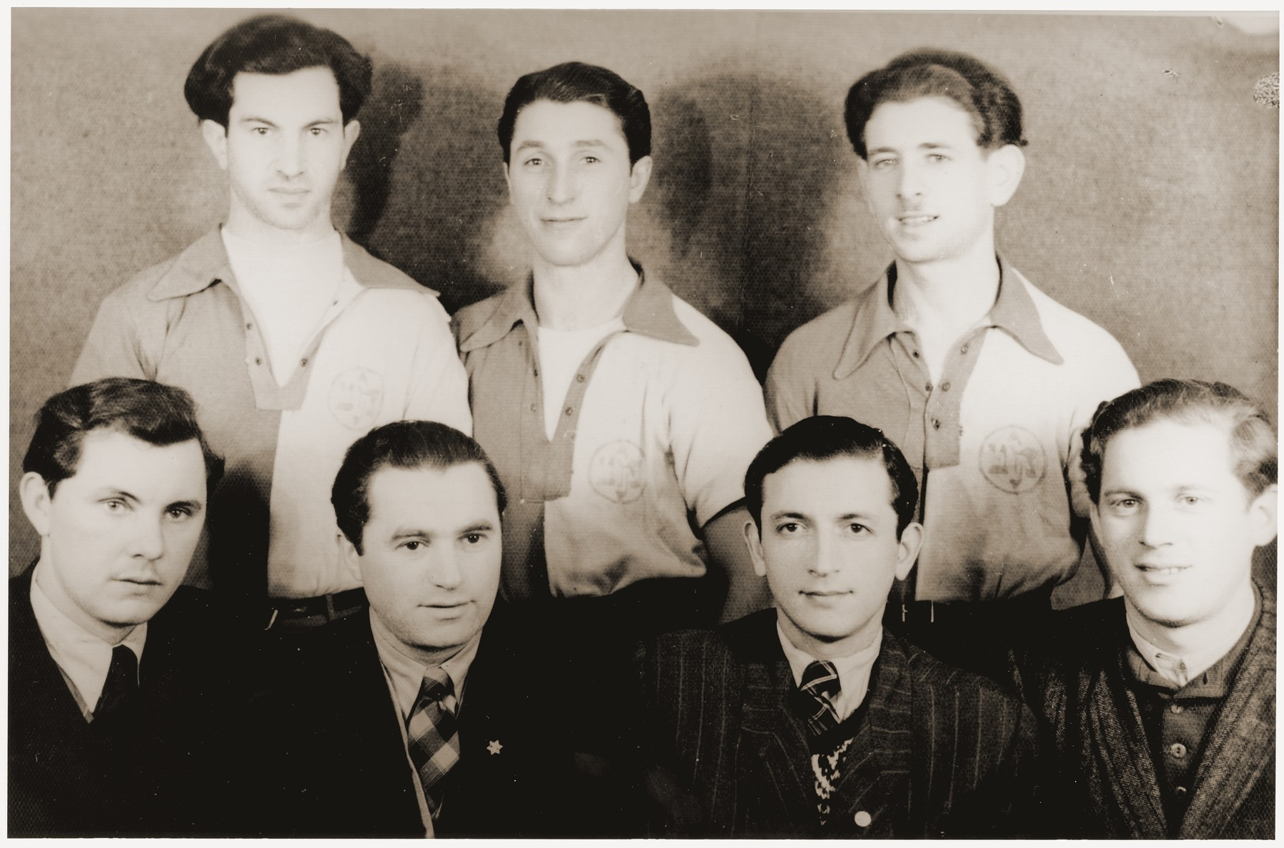 Group portrait of members of a sports team at the Feldafing displaced persons camp.