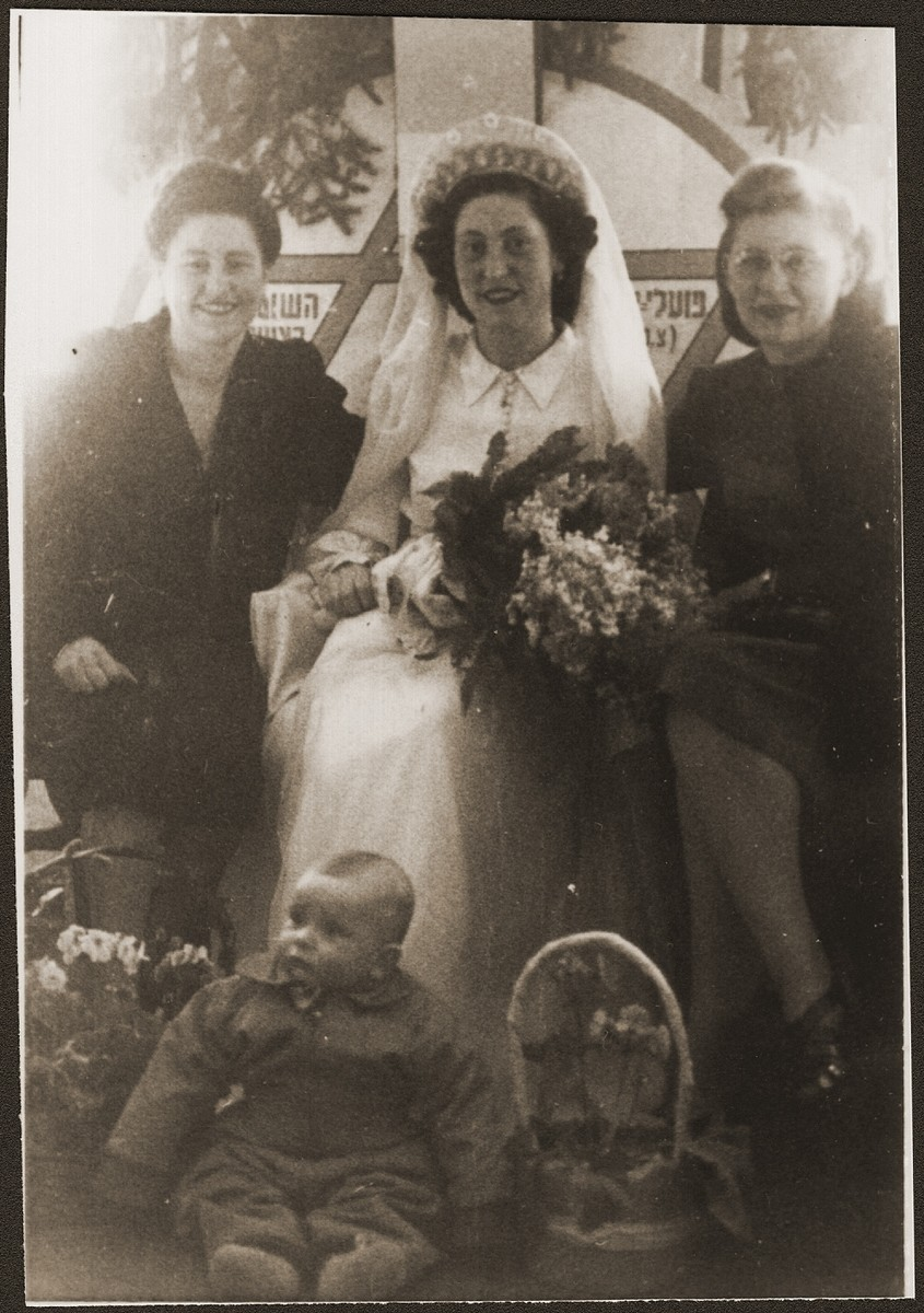 The wedding of Ibby Neuman and Max Mandel at the Bad Reichenhall displaced persons' camp.  On the right is Gertrude Ferencz nee Fried, a cousin of the bride.  She was working as an administrator for the office of Chief of Counsel, War Crimes, Nuremberg.