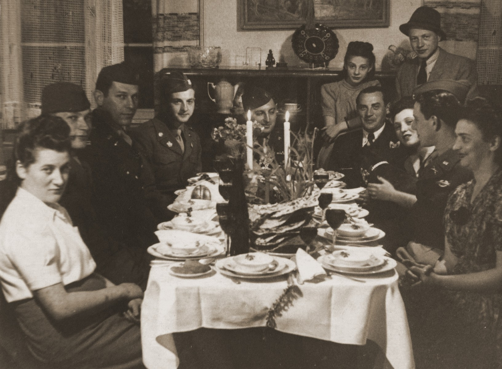 Hinda Chilewicz and Welek Luksenburg attend a Passover seder at the home of Mary Ganzweich in Bayreuth, 1946.   Those pictured include Hinda Luksenburg (far left), Captain Cooly (a CIA member who was assisting the Jewish DPs in Bayreuth), Halinka Merin (the daughter of Mary Gauzweich and Moniek Merin, former head of the Sosnowiec Judenrat), Welek Luksenburg, Henia Szczesliva and Mary Ganzweich.