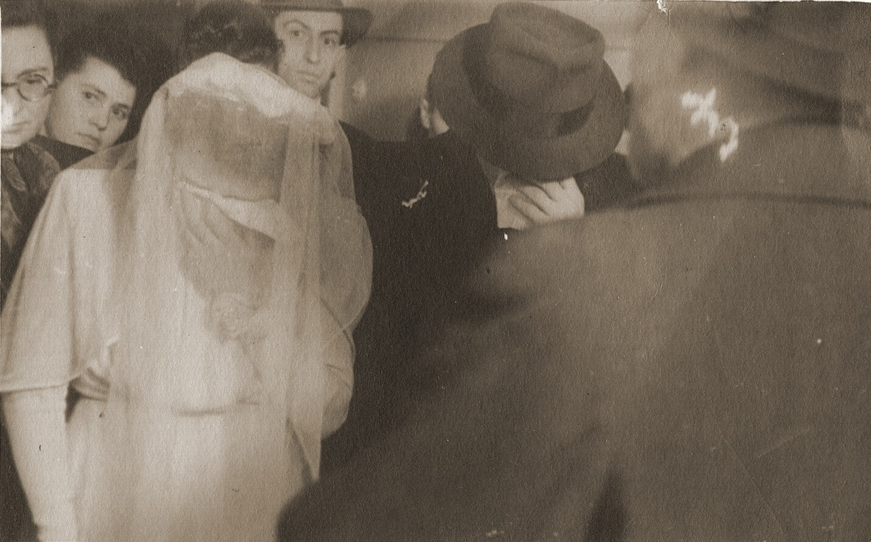 Wedding of Hinda Chilewicz and Welek Luksenburg in the Weiden displaced persons' camp.  The bride and groom weep during the recitation of a prayer in memory of their parents.