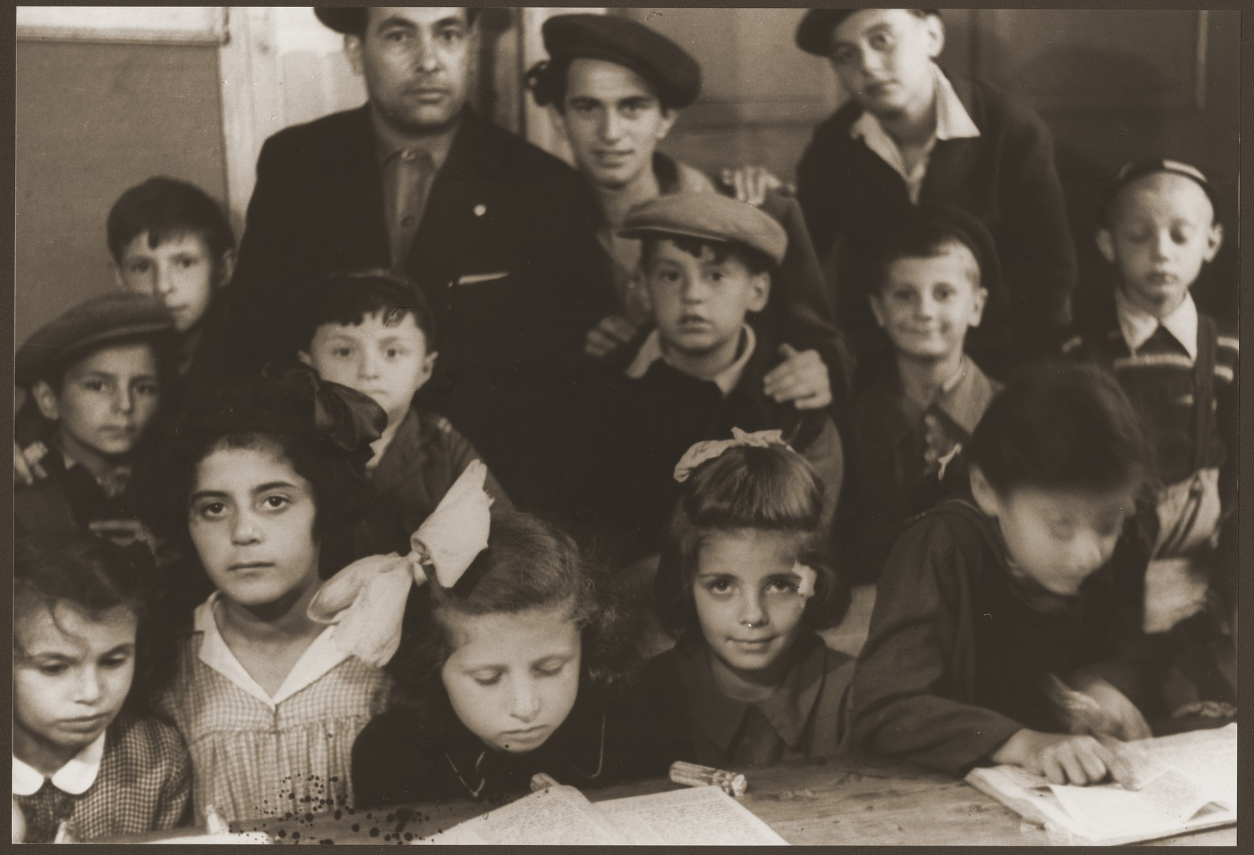 Pupils of the Vaad Hatzala sponsored Yavne Hebrew School at the Gabersee DP camp.  Those pictured include Bronia Spielman, Alter Spielman, Barbara Spielman Firestone (front row, far left), and Arthur Spielman (back row, center, wearing cap).
