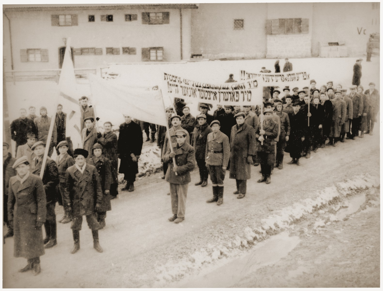 Jewish DPs at the Feldafing displaced persons camp march in protest against the refusal of the British government to open the gates of Palestine to Jewish immigration.