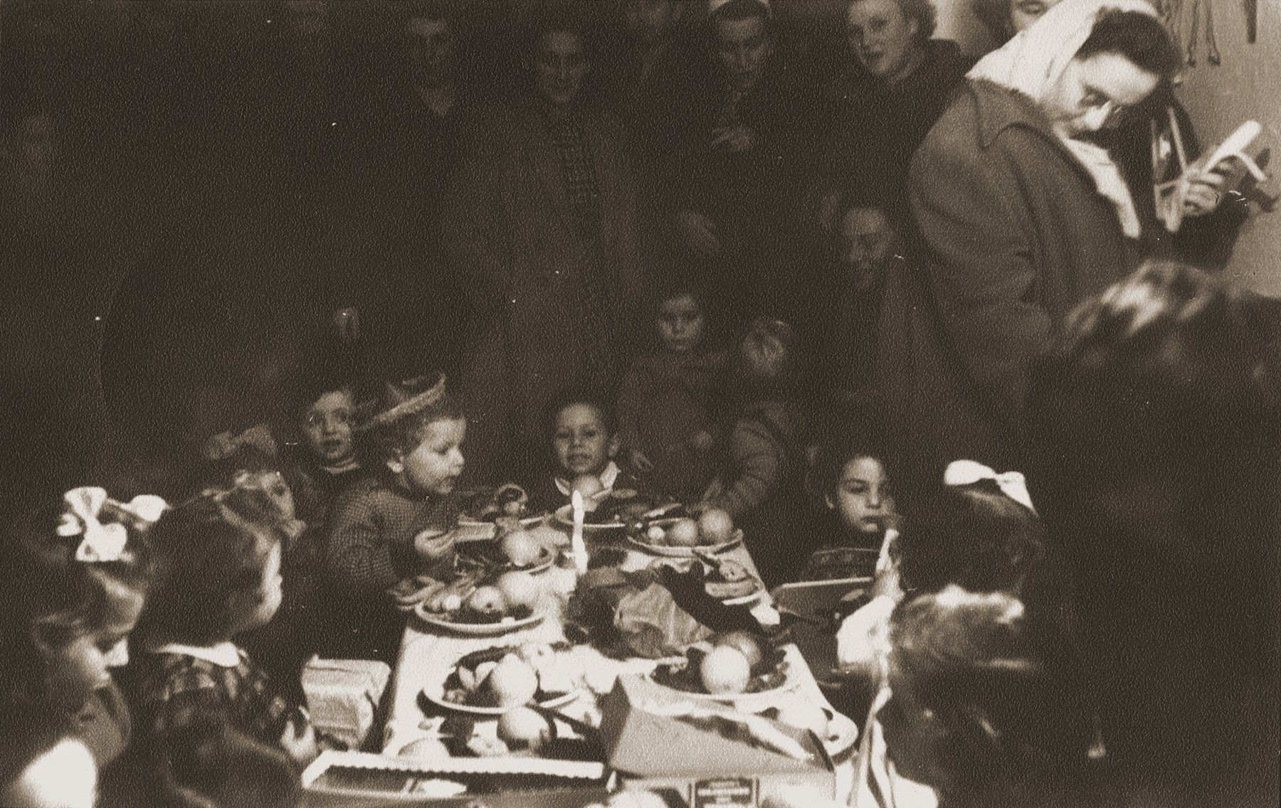 Pre-school children who were born in  the Bergen-Belsen displaced persons' camp, attend a birthday party at the camp.