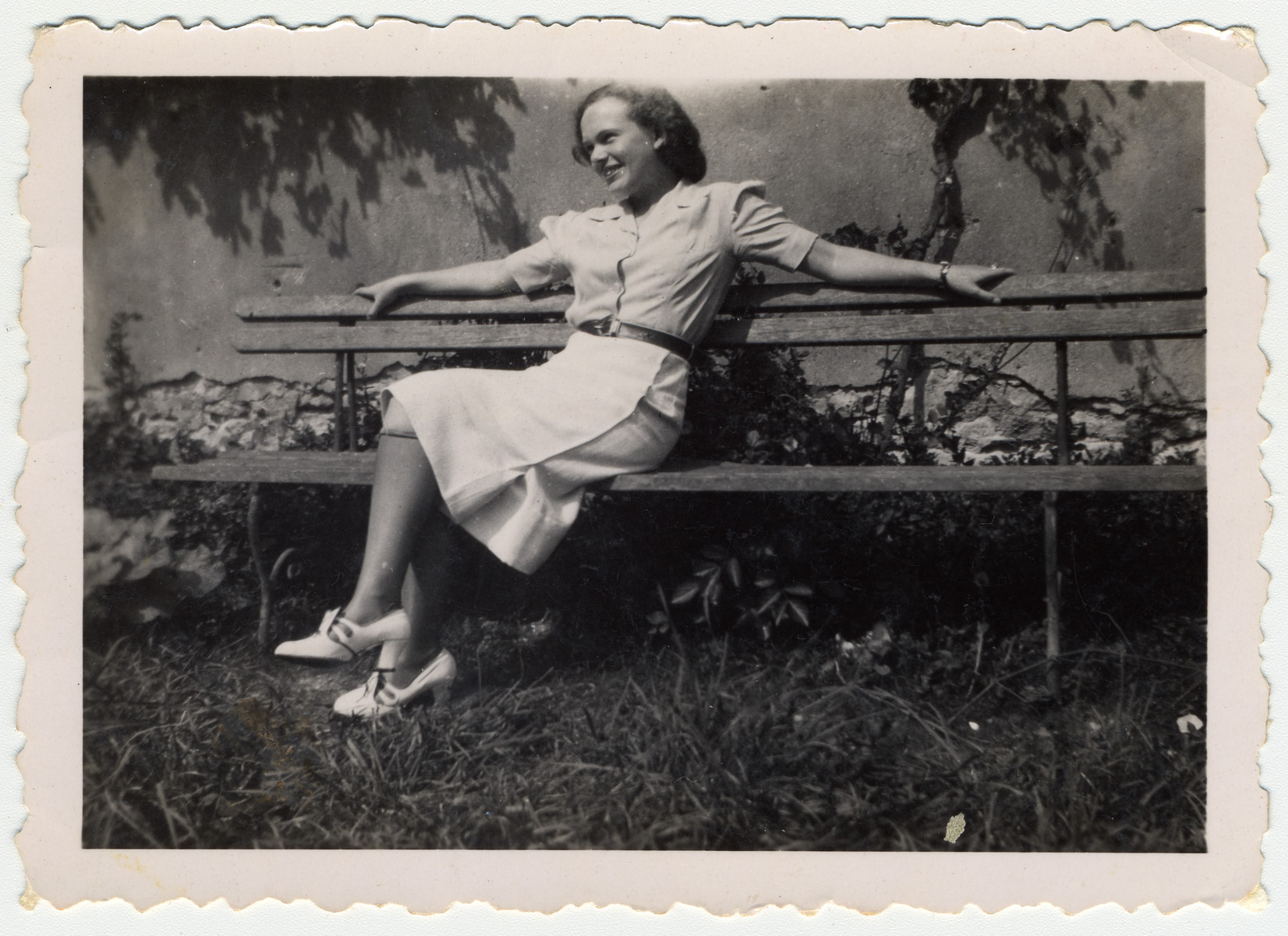 A young Jewish woman relaxes on an outdoor bench in Mirabeau, France.  Pictured is Ilse Karliner.  A few months later she was sent to Drancy and from there to Auschwitz where she perished.