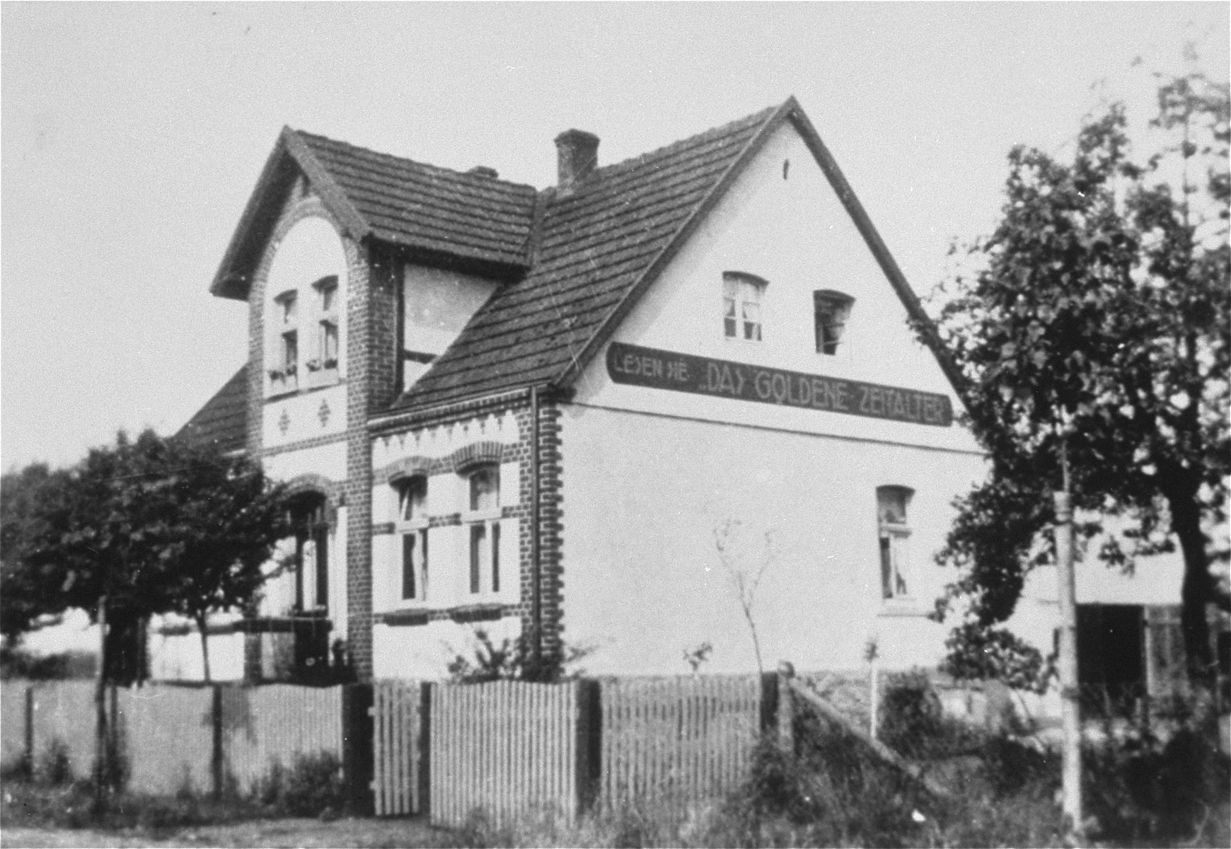 "The Kusserow family home in Bad Lippspringe, including the sign ""Read the Golden Age [magazine]""."